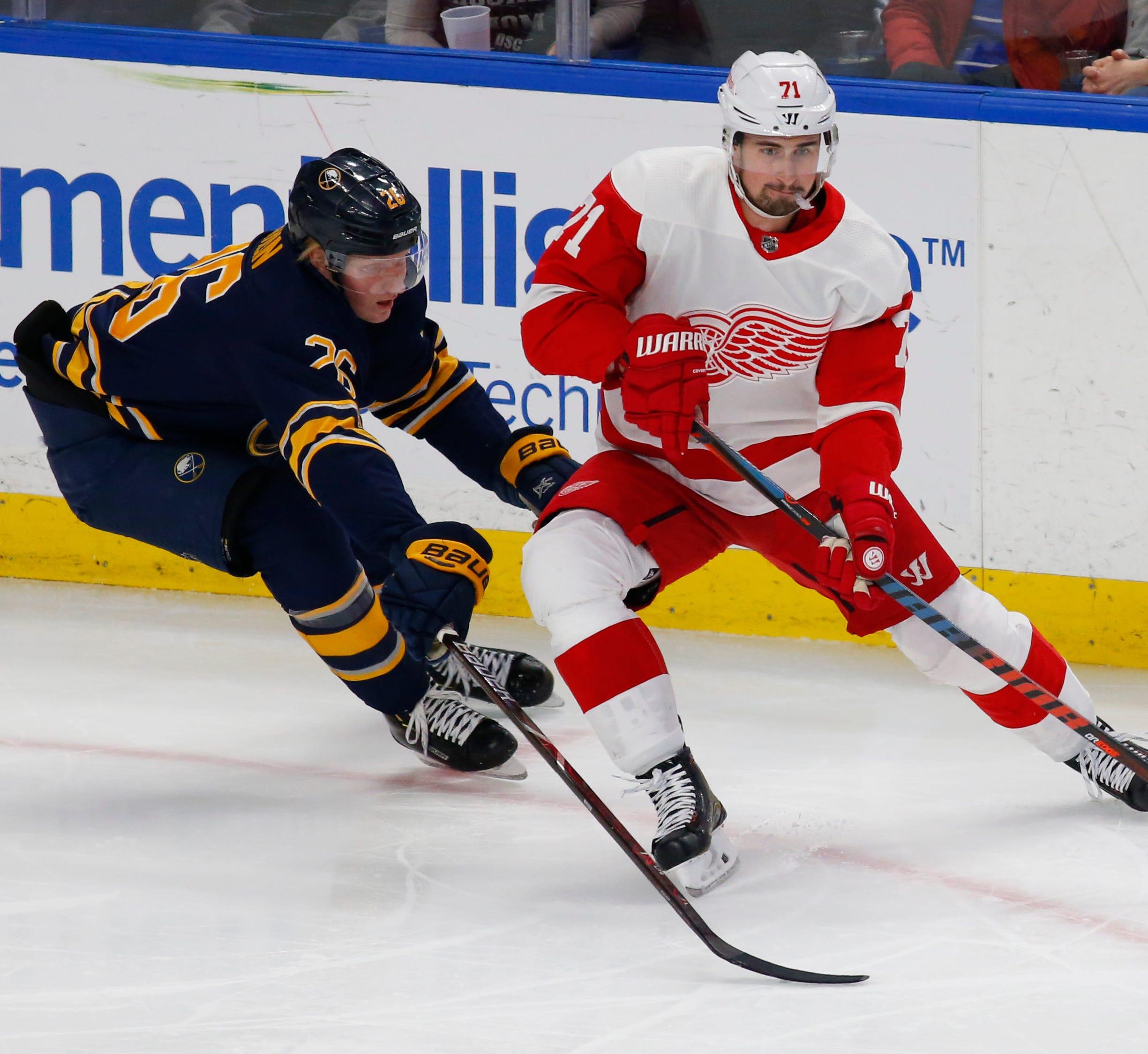 Sabres defenseman Rasmus Dahlin defends Red Wings forward Dylan Larkin during the first period on Saturday, Feb. 9, 2019, in Buffalo N.Y.