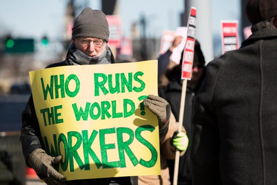 David Walsh, Southfield, has been supporting World Social Website protests outside General Motors headquarters in Detroit, Saturday, February 9, 2019.