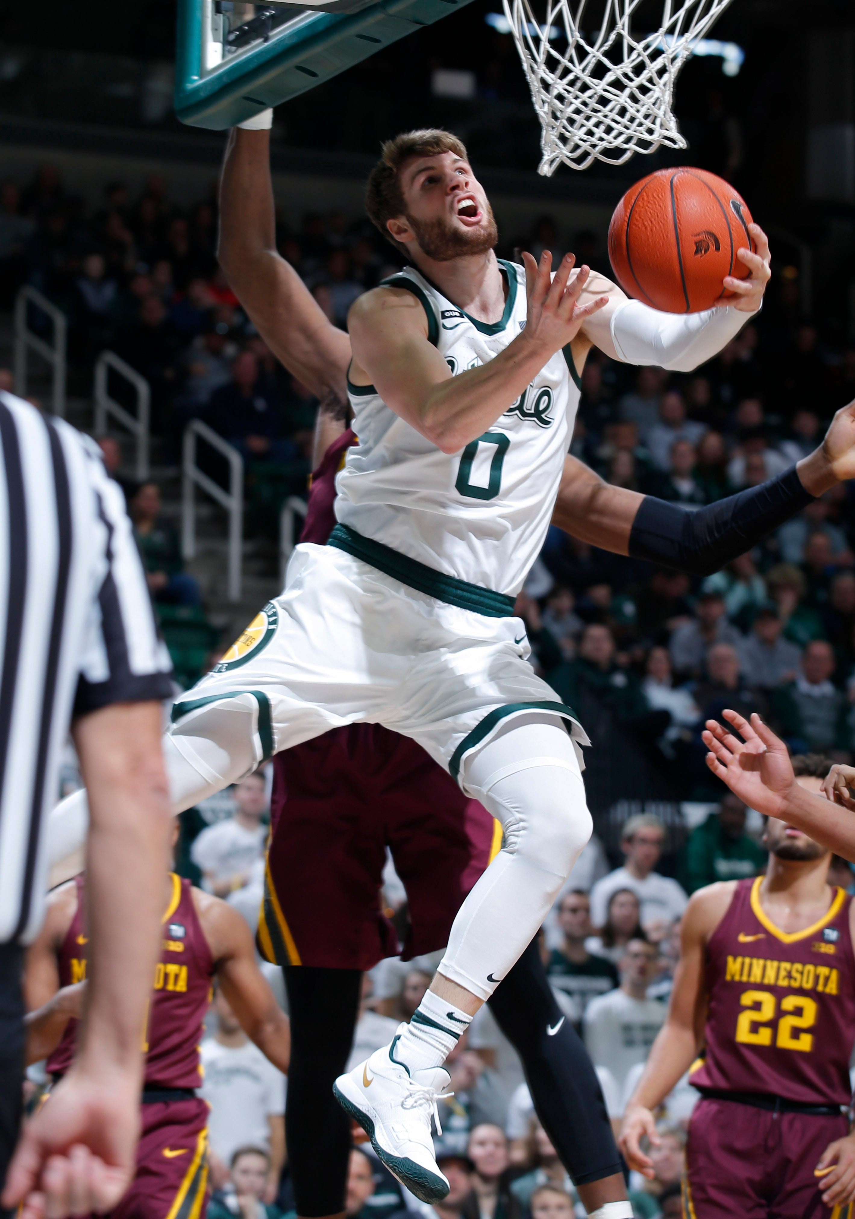 Michigan State's Kyle Ahrens goes to the basket against Minnesota, Feb. 9, in East Lansing.