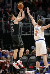 Detroit Pistons guard Sviatoslav Mykhailiuk shoots against New York Knicks forward Luke Kornet during the fourth period Friday, Feb. 8, 2019 at Little Caesars Arena.