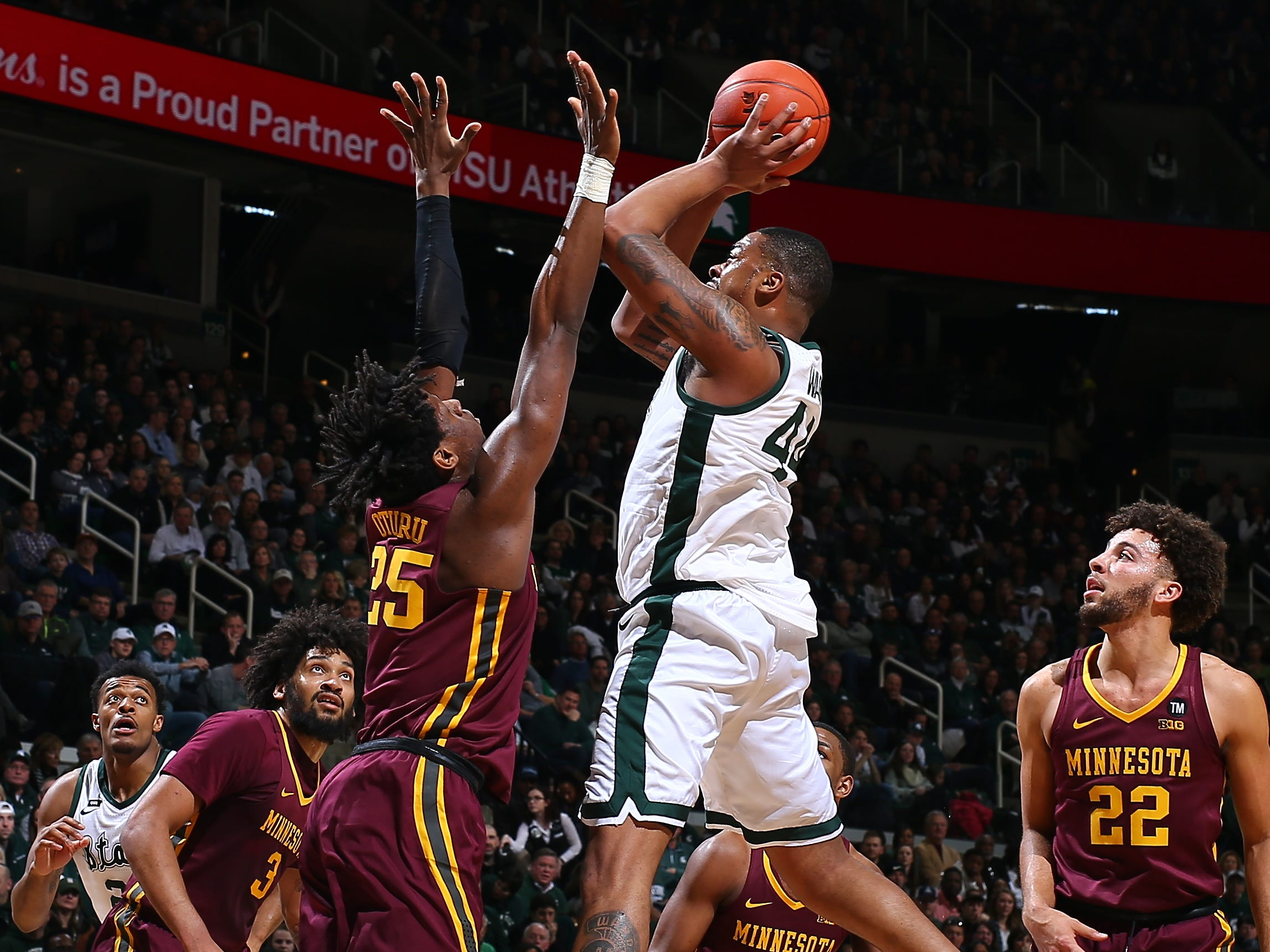 Michigan State's Nick Ward shoots the ball over Minnesota's Daniel Oturu in the first half at Breslin Center on Saturday, Feb. 9, 2019, in East Lansing.