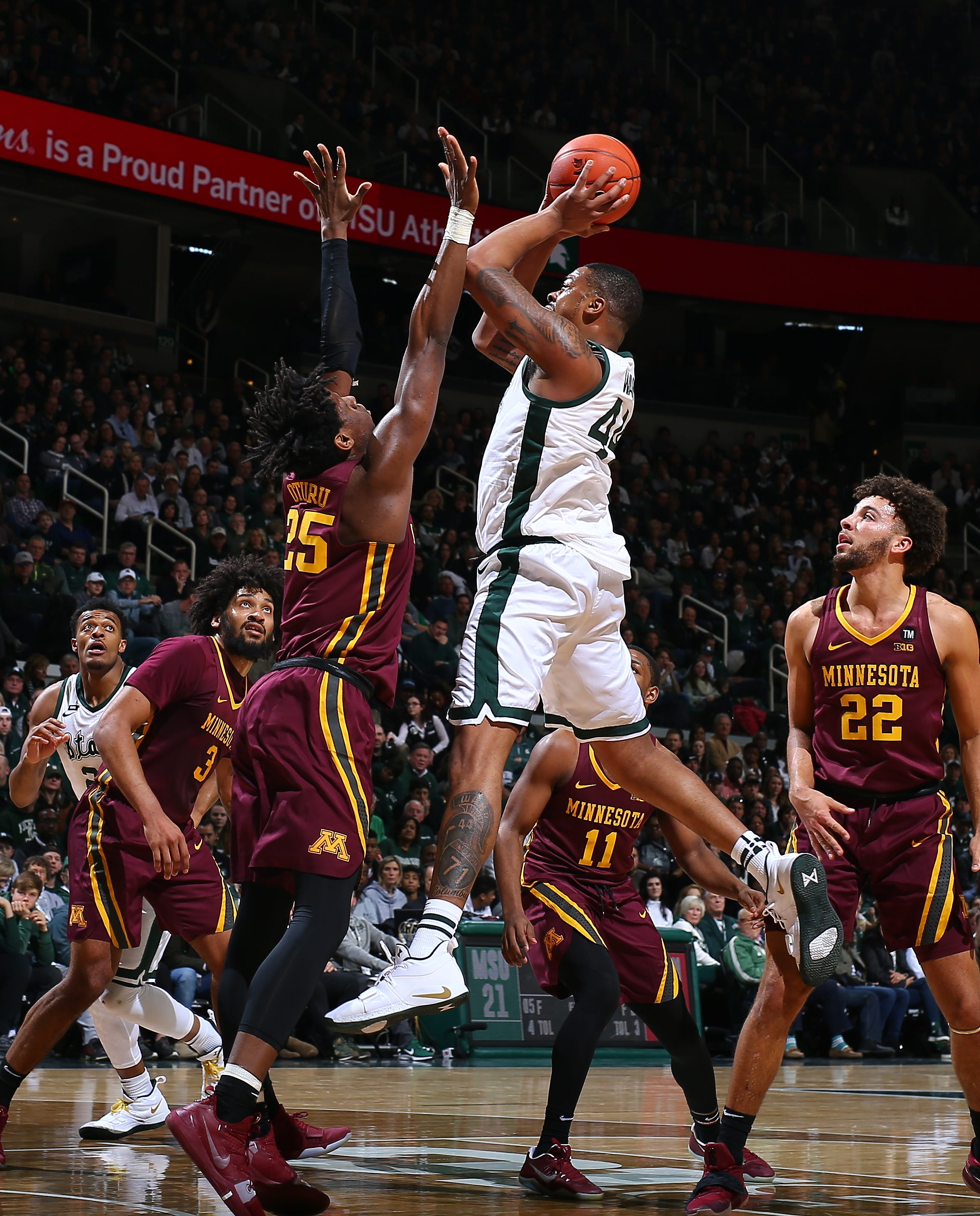 Nick Ward of Michigan State scores the ball over Minnesota's Daniel Oturu's first half at the Breslin Center on Saturday, February 9, 2019, in East Lansing.