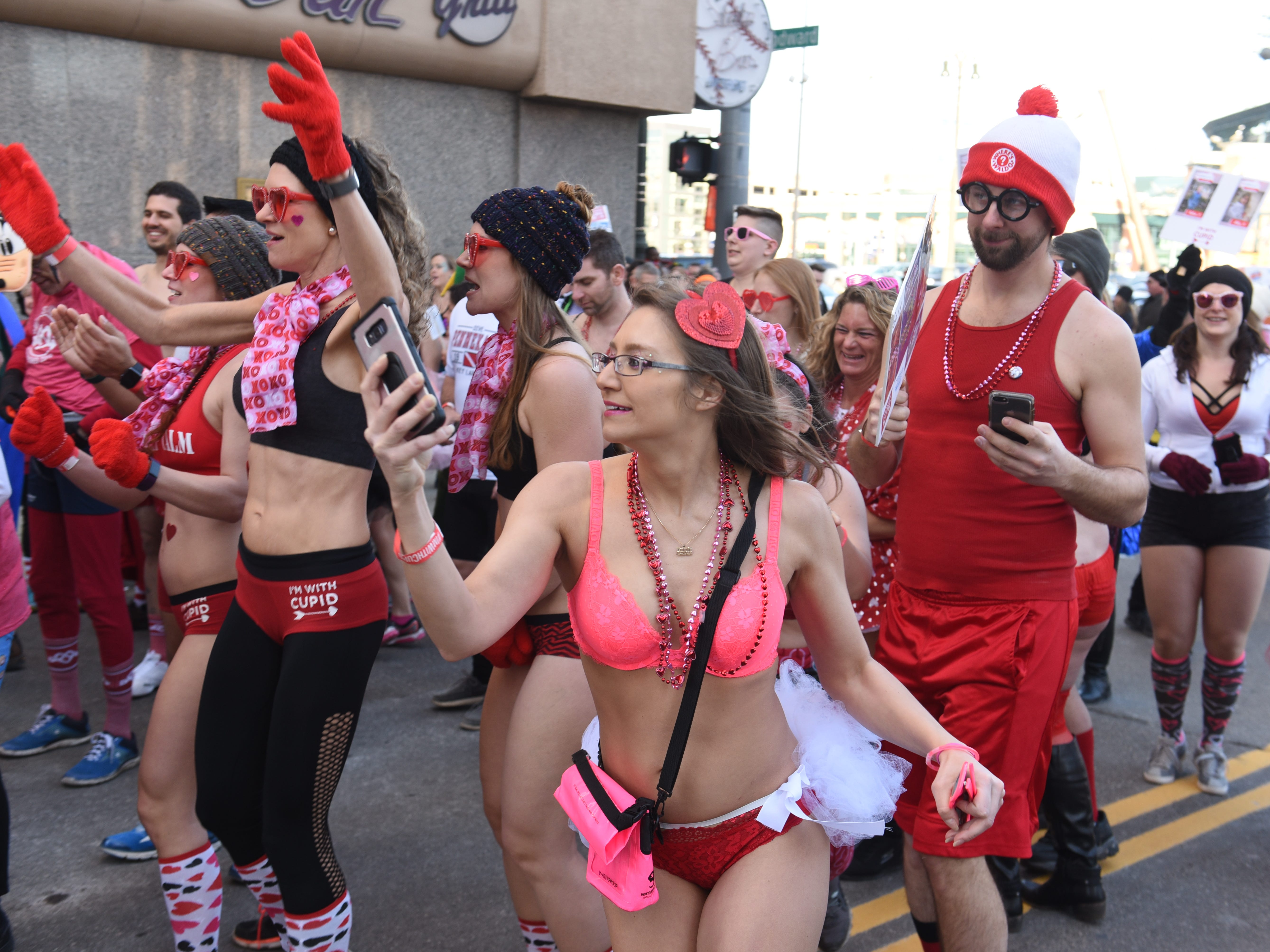 Tera Kleiner (center) of Harrison Township runs through the crowd during  Cupid's Undie Run
