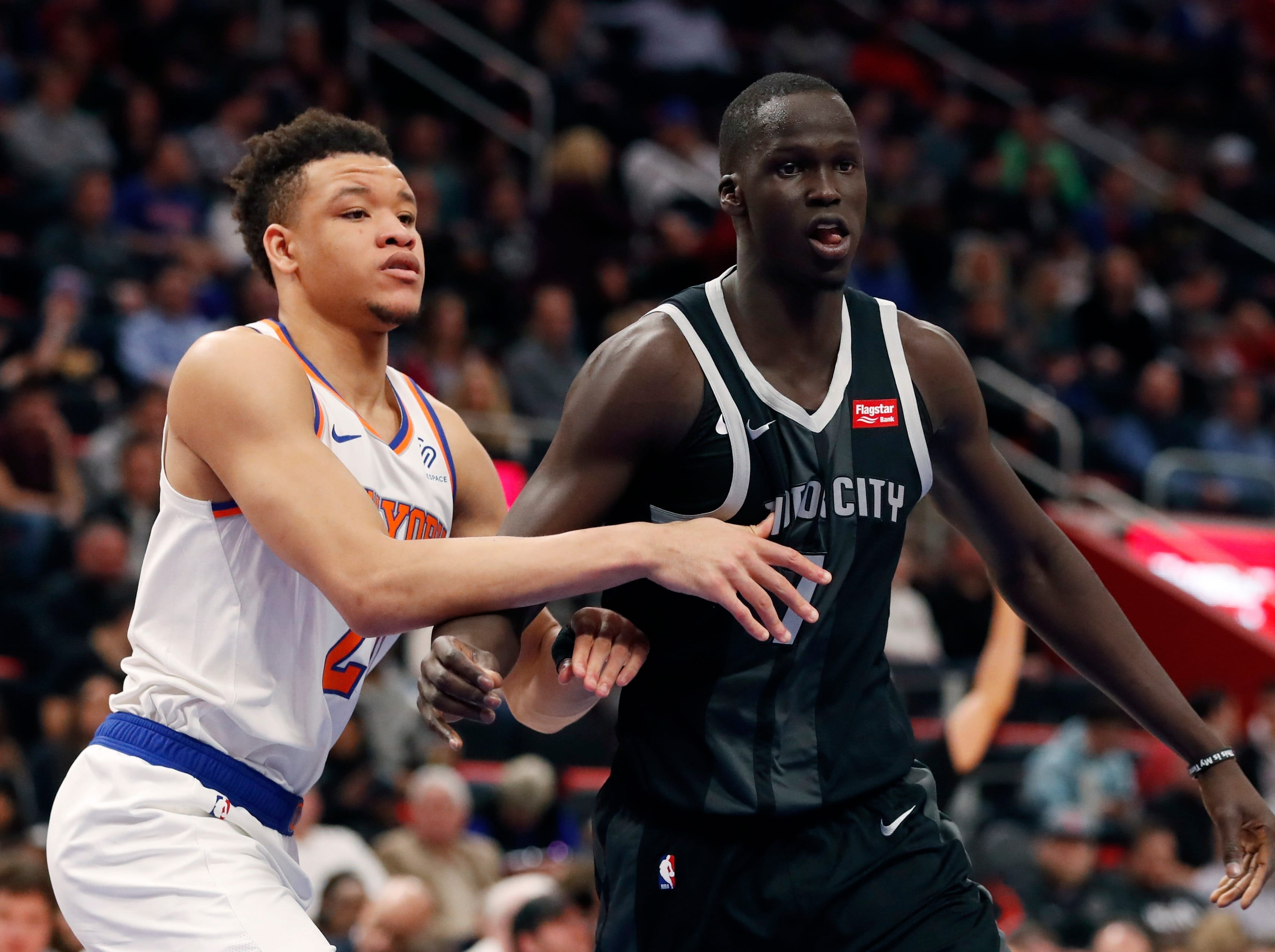 New Detroit Pistons forward Thon Maker (7) is defended by New York Knicks forward Kevin Knox during the first half of an NBA basketball game Friday, Feb. 8, 2019, in Detroit.