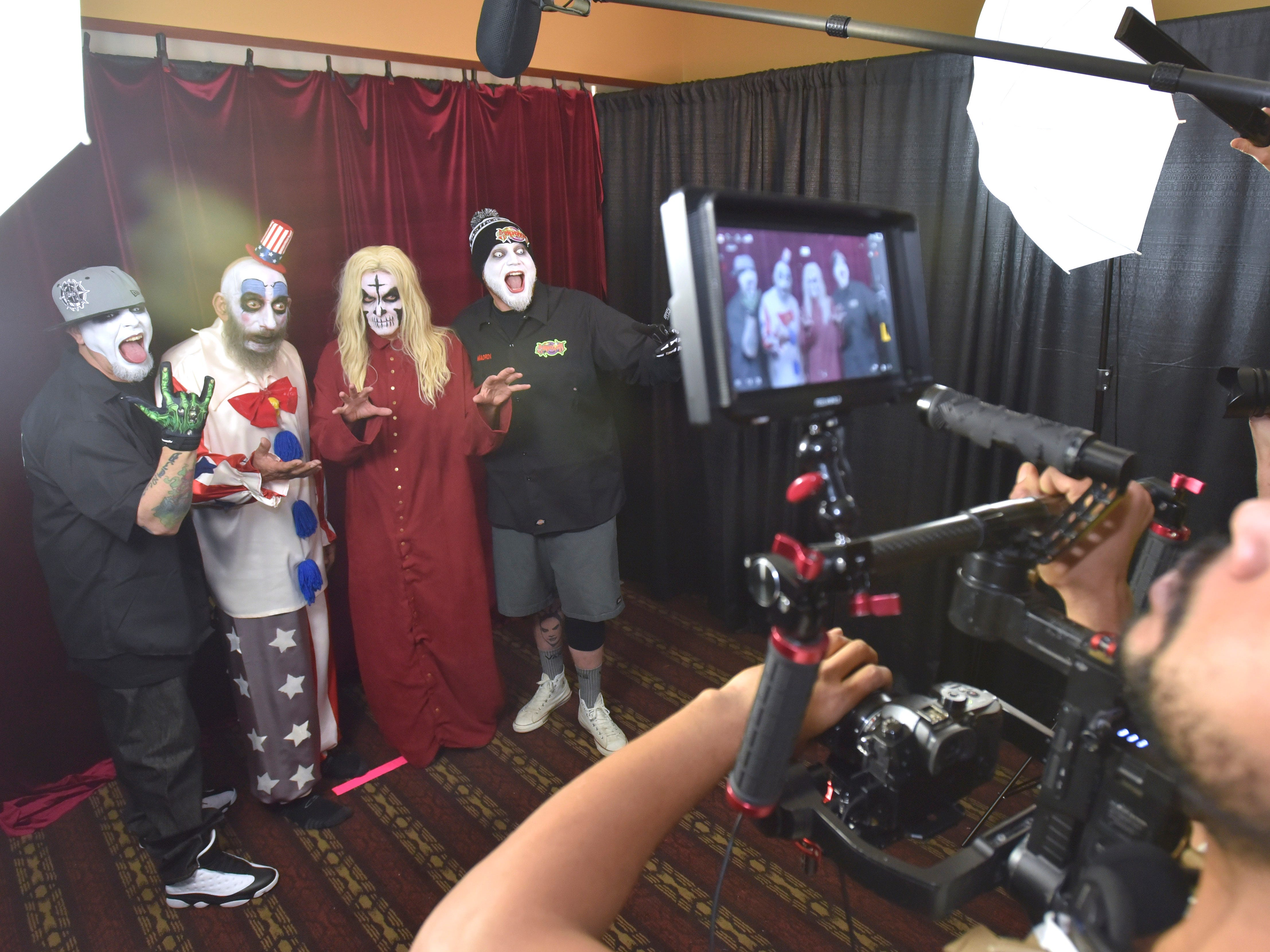 Rob Zombie's slasher / horror movie House of 1000 Corpses characters 'Captain Spaulding,' center-left, portrayed by Sid Haig, and 'Otis B. Driftwood,' center-right, portrayed by Bill Moseley, pose with Detroit recording artists Monoxide, left, and Jamie Madrox, right, from Twiztid at the Hollywood Photo Ops portrait booth.