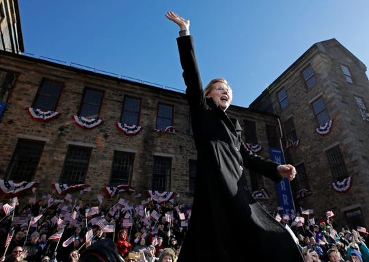 Sen. Elizabeth Warren, D-Mass., waves to supporters as she takes the stage during an event to formally launch her presidential campaign, Saturday, Feb. 9, 2019, in Lawrence, Mass.