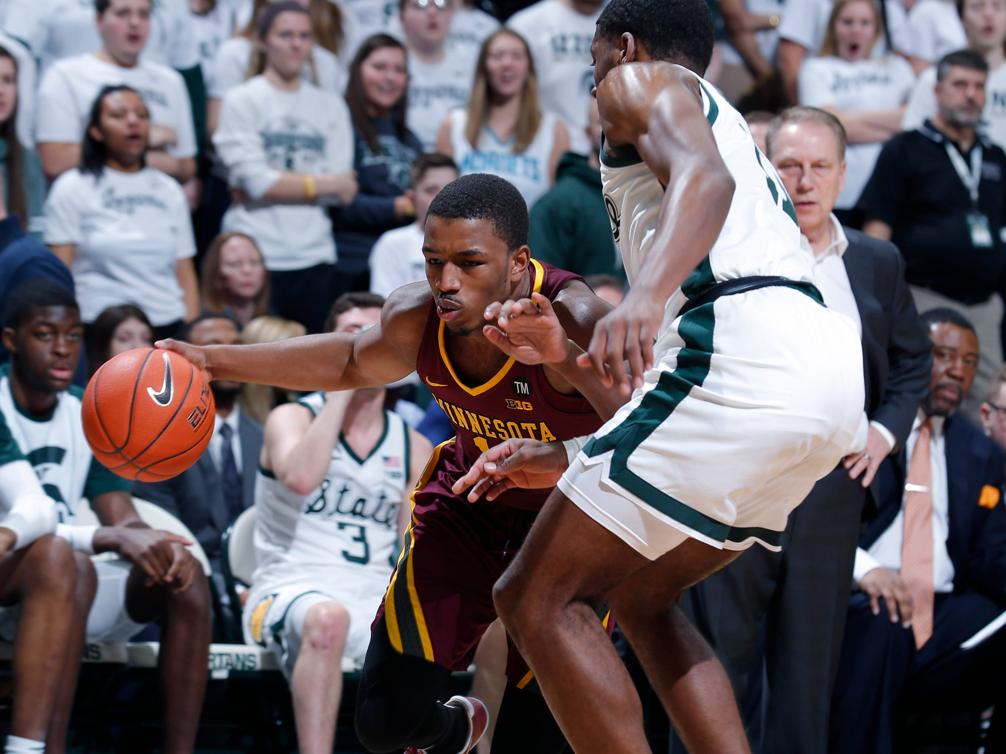Minnesota's Isaiah Washingotn, left, drives against Michigan State's Aaron Henry during the first half.