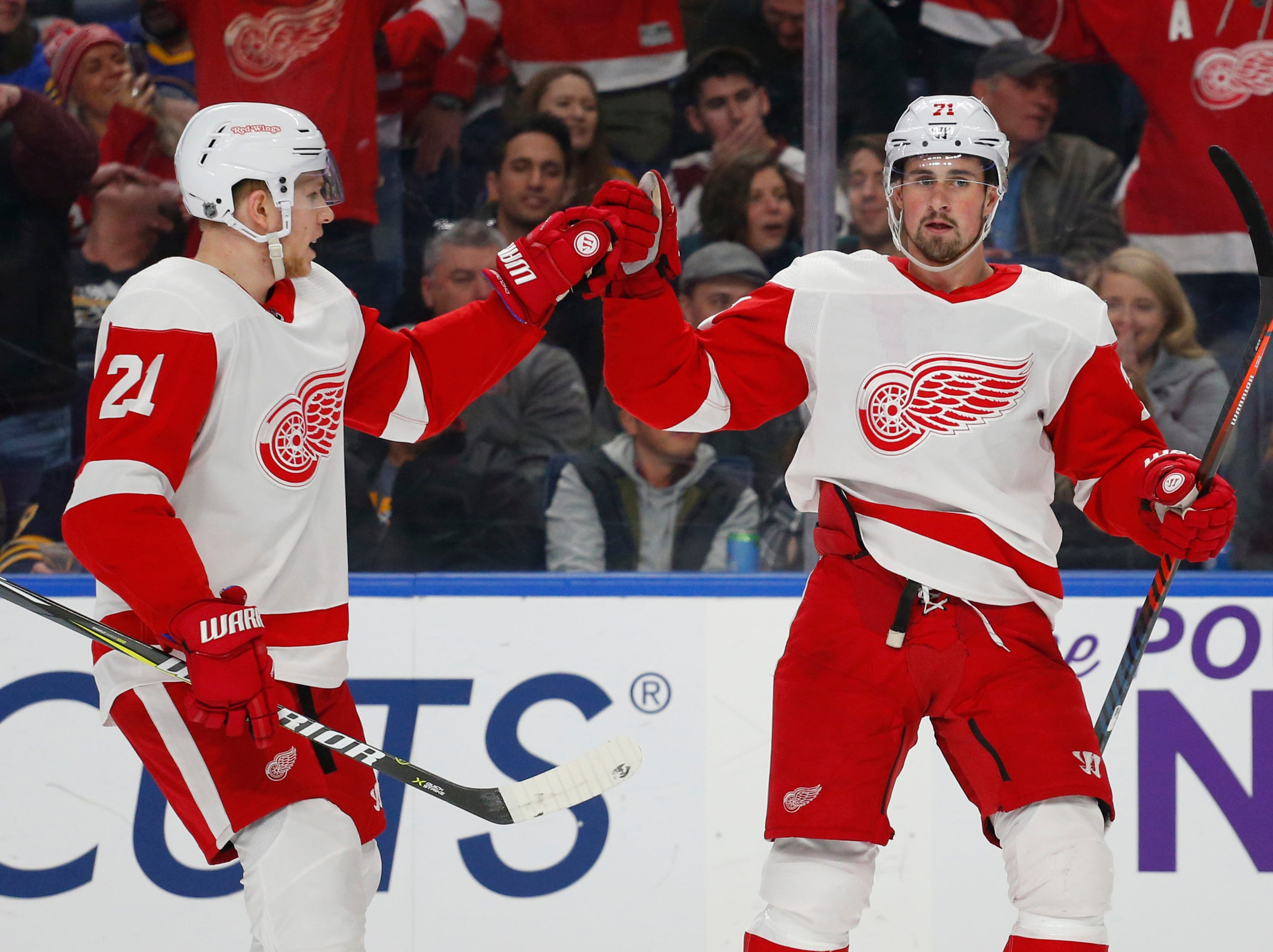 Detroit Red Wings defenseman Dennis Cholowski (21) and forward Dylan Larkin (71) celebrate a goal during the second period of an NHL hockey game against the Buffalo Sabres, Saturday, Feb. 9, 2019, in Buffalo N.Y. (AP Photo/Jeffrey T. Barnes)