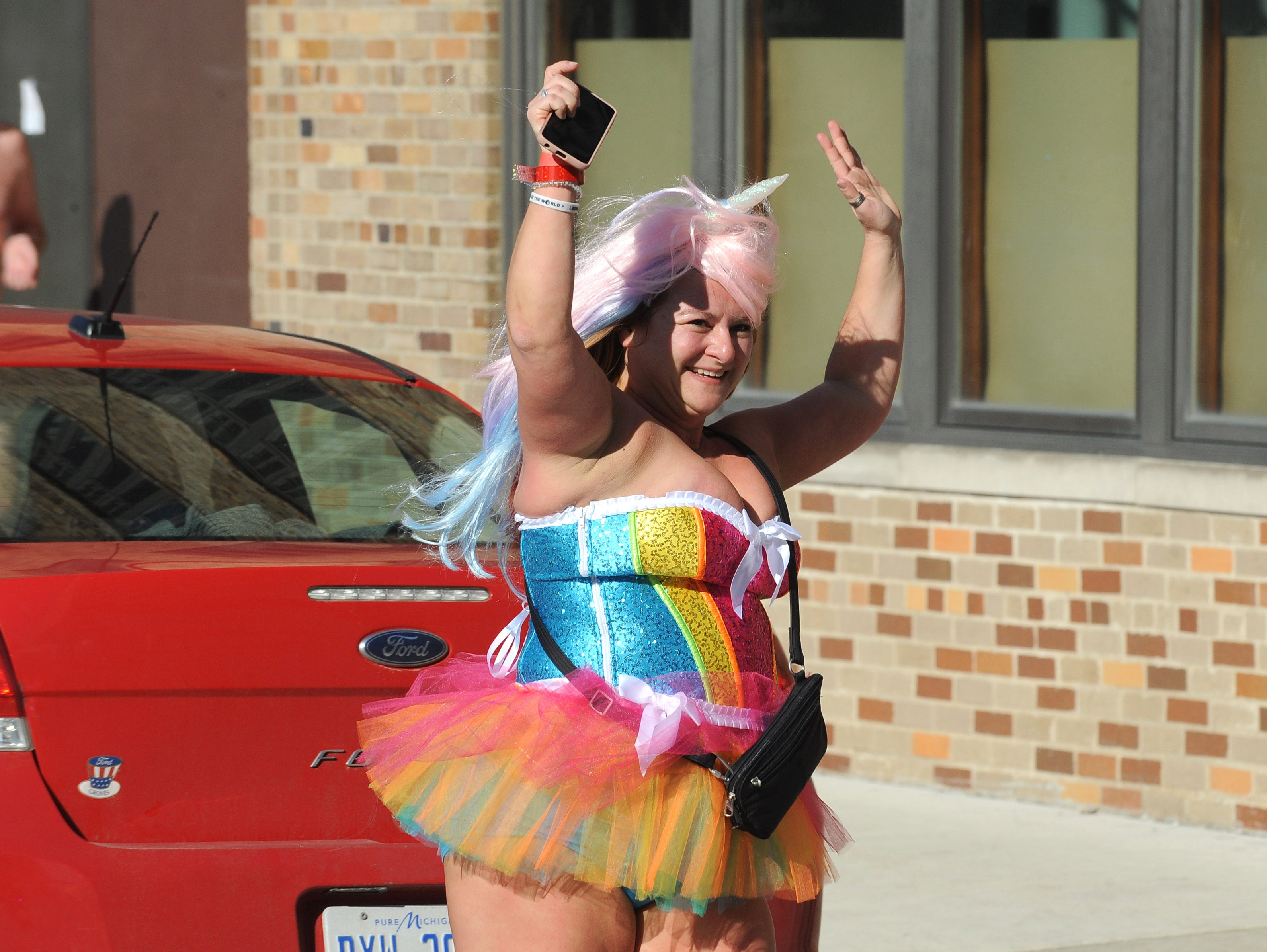 A participant wore multicolored skirt and ran Cupid's Undie Run.