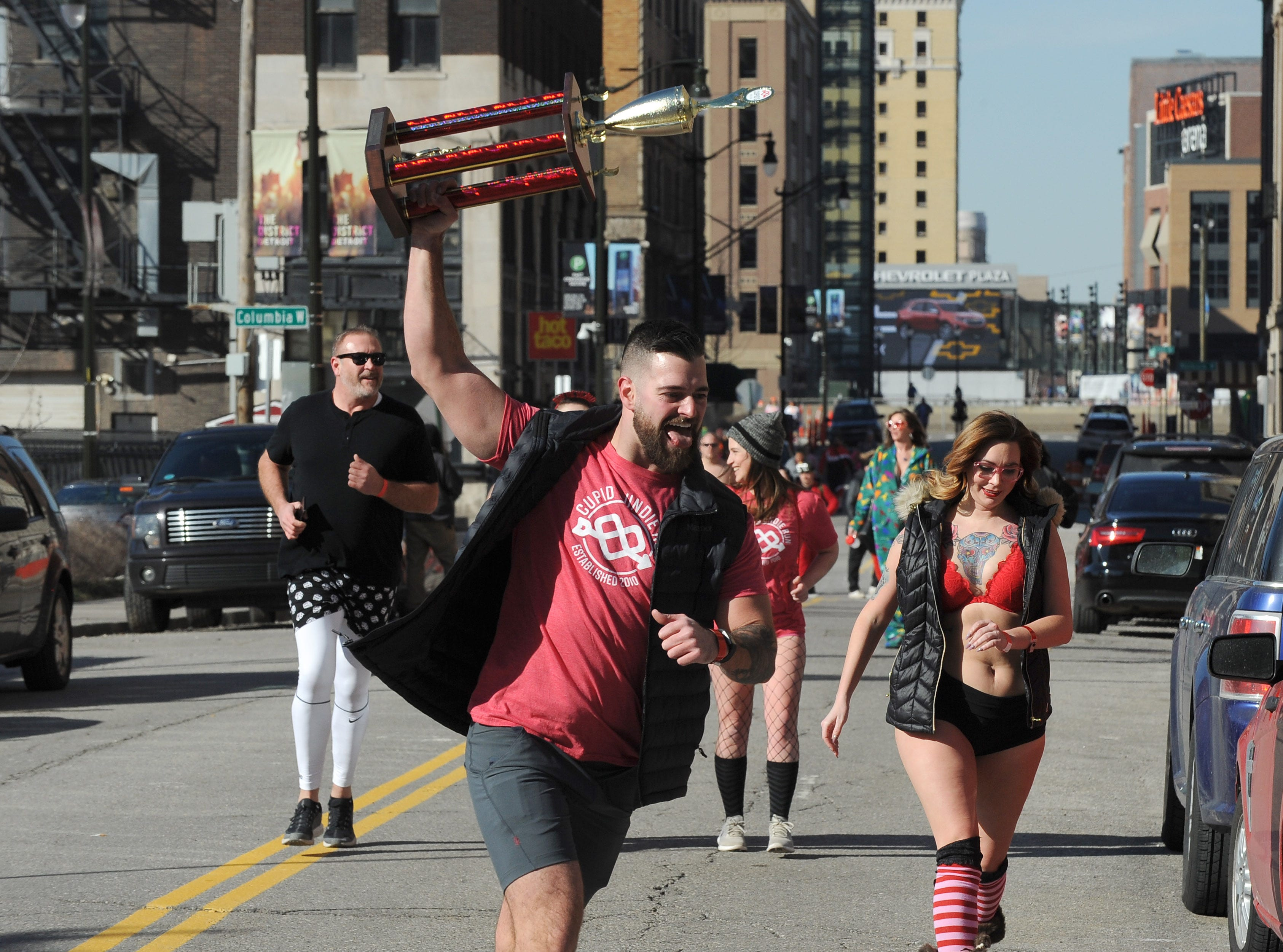 Participants even carried trophy's while heading to the finish for Cupid's Undie Run.