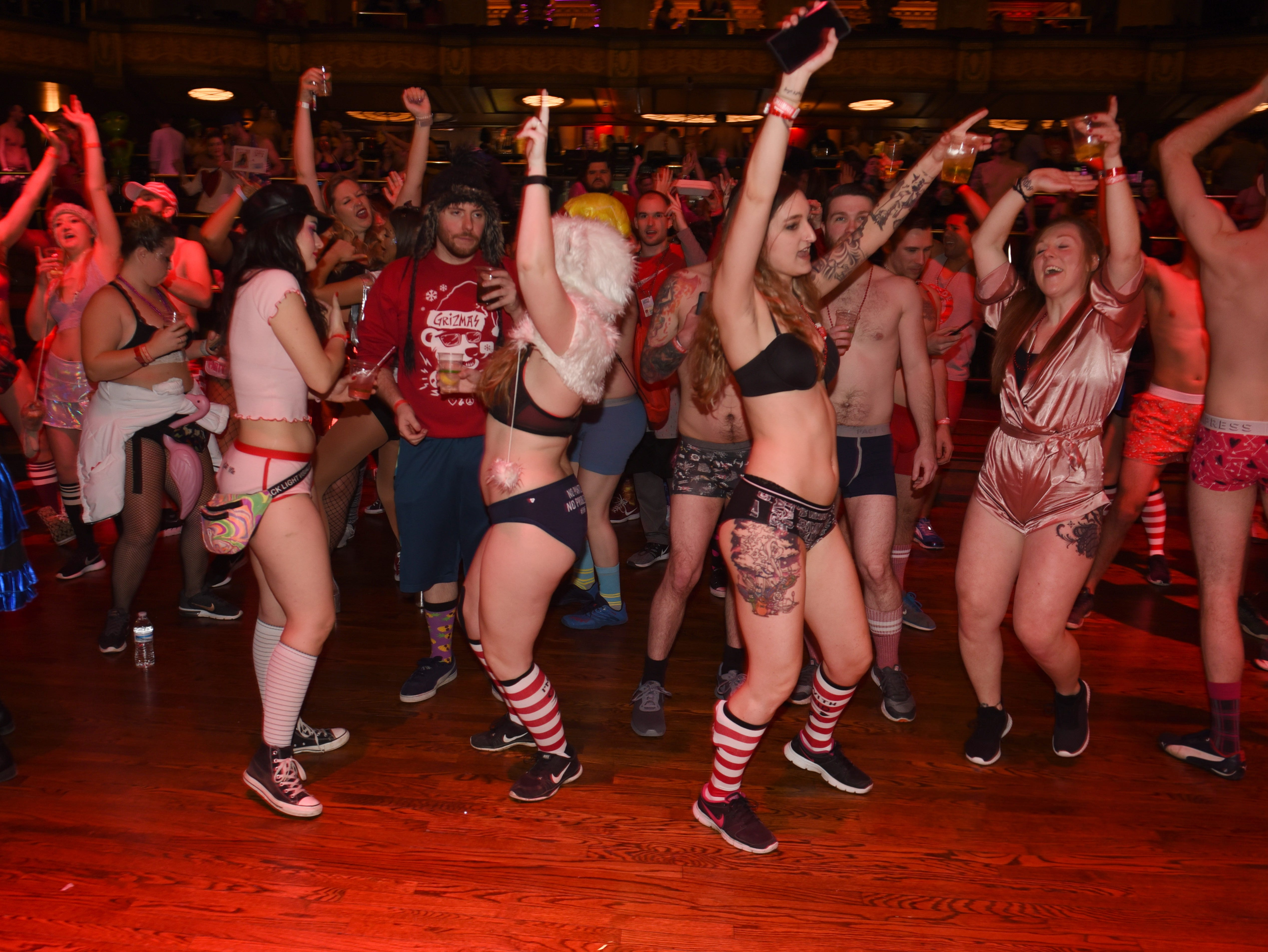 Participants dance and party at The Fillmore Detroit for Cupid's Undie Run on Saturday, February 9, 2019.