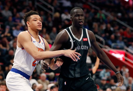 New Detroit Pistons forward Thon Maker is defended by New York Knicks forward Kevin Knox during the first half Friday night.