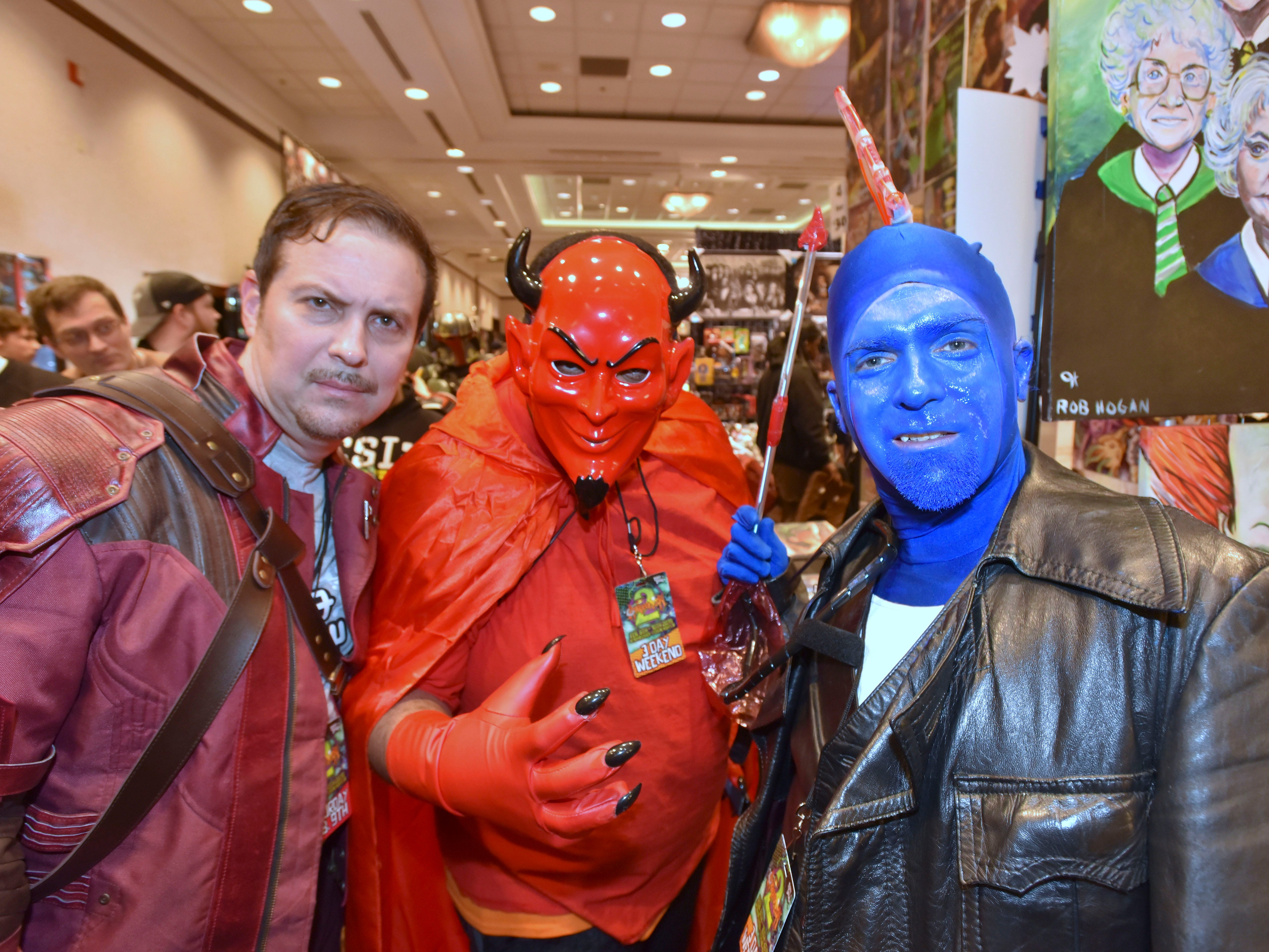 Mike Kars, left, 46, of Madison Heights, portrays Star-Lord as Quinn Spencer, right, 46, of Ferndale, portrays Yondu, both from Guardians of the Galaxy, as DeVante Backer, center, 26, of Warren, portrays Red Devil from Scream Queens.
