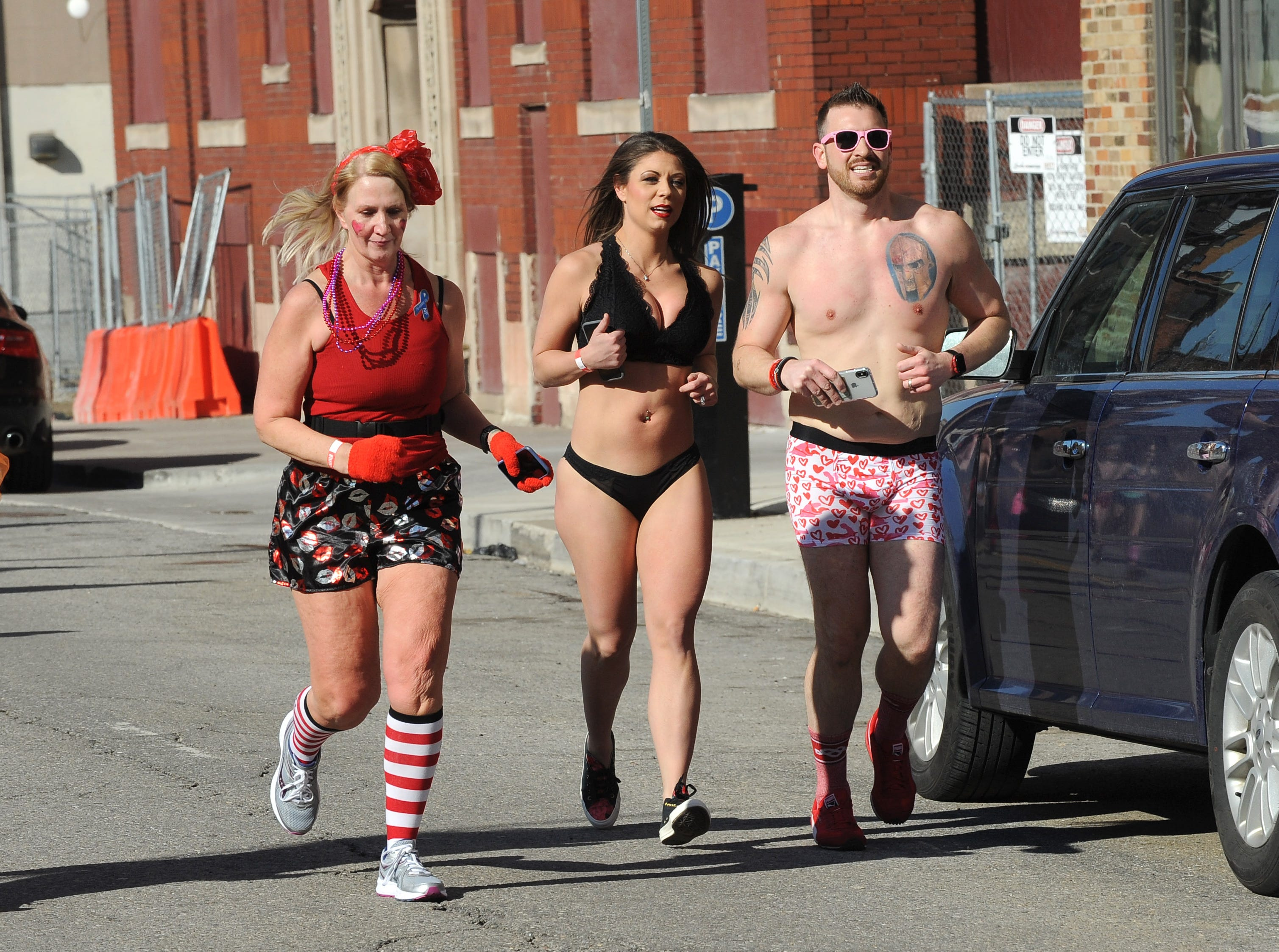 Participants tossed their winter coats and gloves as they hit the streets of Detroit for Cupid's Undie Run.