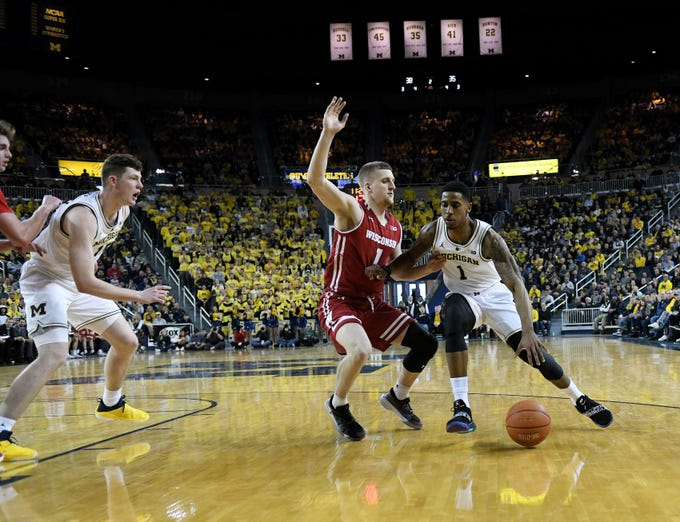 Wisconsin guard Brevin Pritzl (1) guards Michigan guard Charles Matthews (1) in the second half.   Michigan wins, 61-52 at Crisler Center in Ann Arbor, Mich. on Feb. 9, 2019.