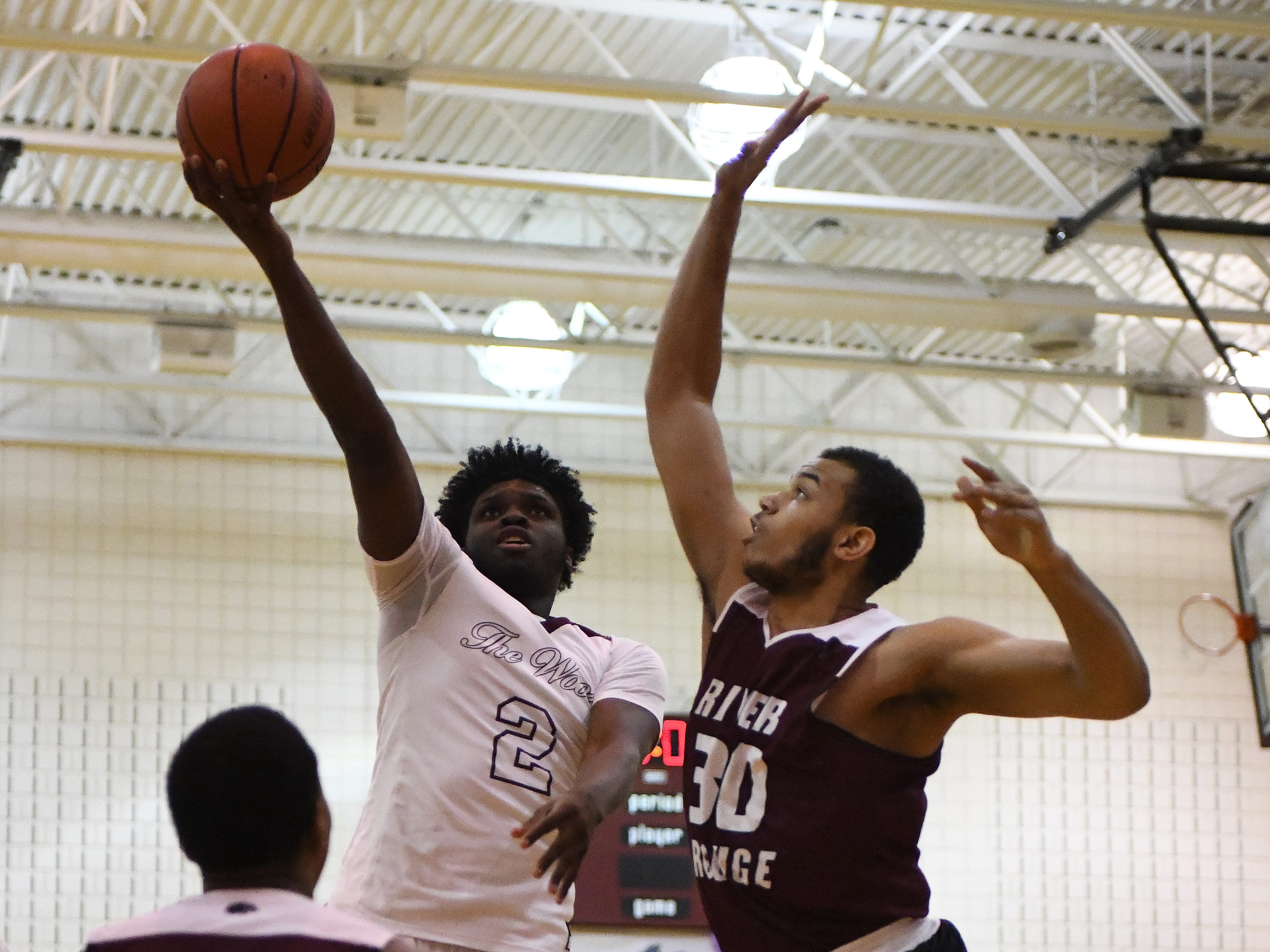 Harper Wood's Ken Thomas goes against River Rouge's Dan Few in the first half.