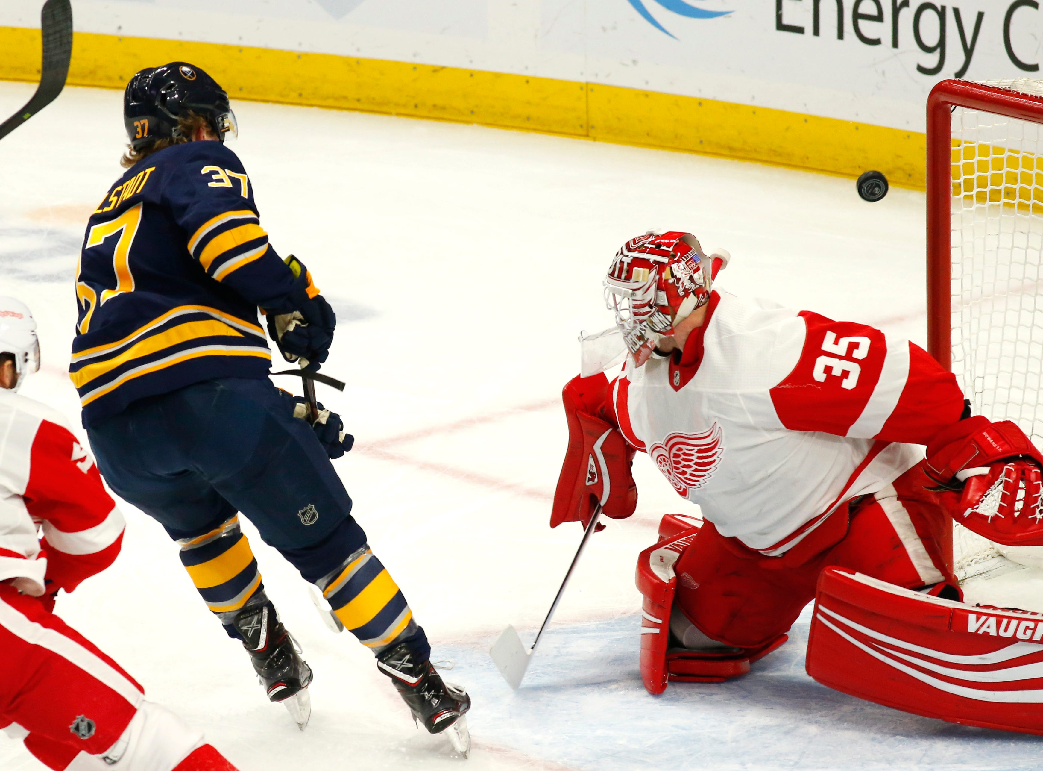Buffalo Sabres forward Casey Mittelstadt (37) shoots the puck wide of Detroit Red Wings goalie Jimmy Howard (35) during the first period of an NHL hockey game, Saturday, Feb. 9, 2019, in Buffalo N.Y. (AP Photo/Jeffrey T. Barnes)