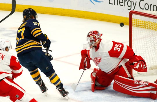 Buffalo Sabres forward Casey Mittelstadt (37) shoots the puck wide of Detroit Red Wings goalie Jimmy Howard (35) during the first period Saturday. Mittelstadt had one of the goals in a 3-1 Sabres' victory.