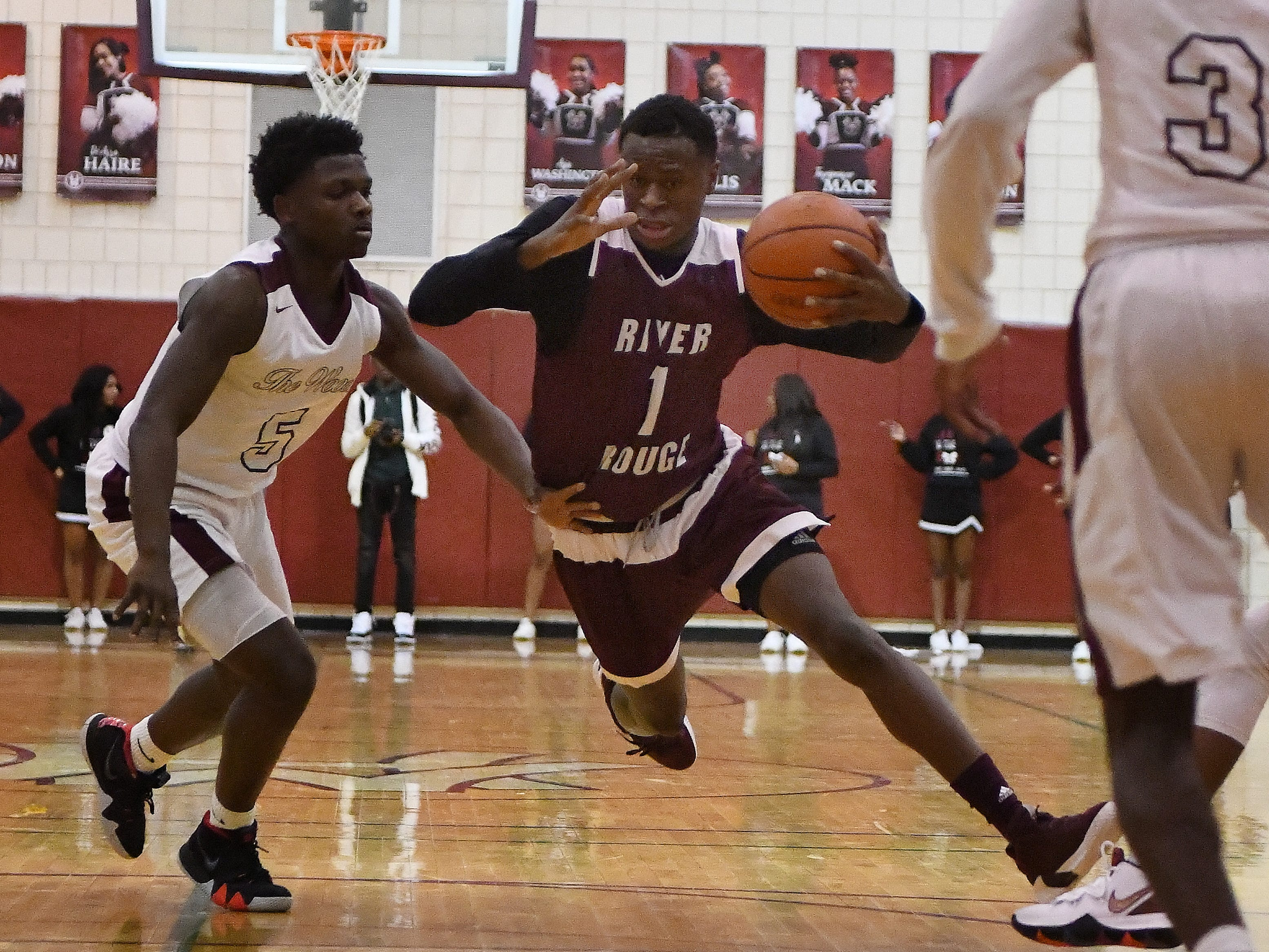 River Rouge's Donavon Freeman drives to the basket in the second half of the 60-45 victory over Harper Woods in Harper Woods, Michigan on February 8, 2019.