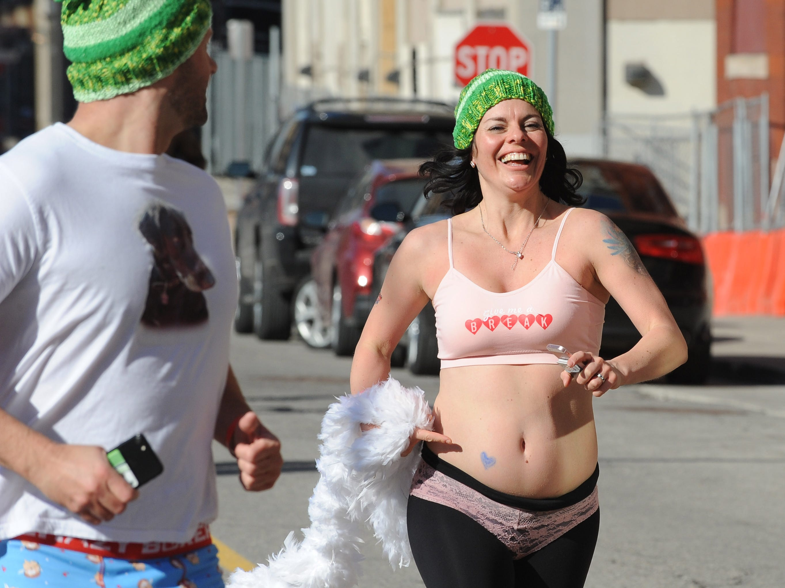 Bare skin and matching green hats were seen at Cupid's Undie Run on Saturday, February 9, 2019.