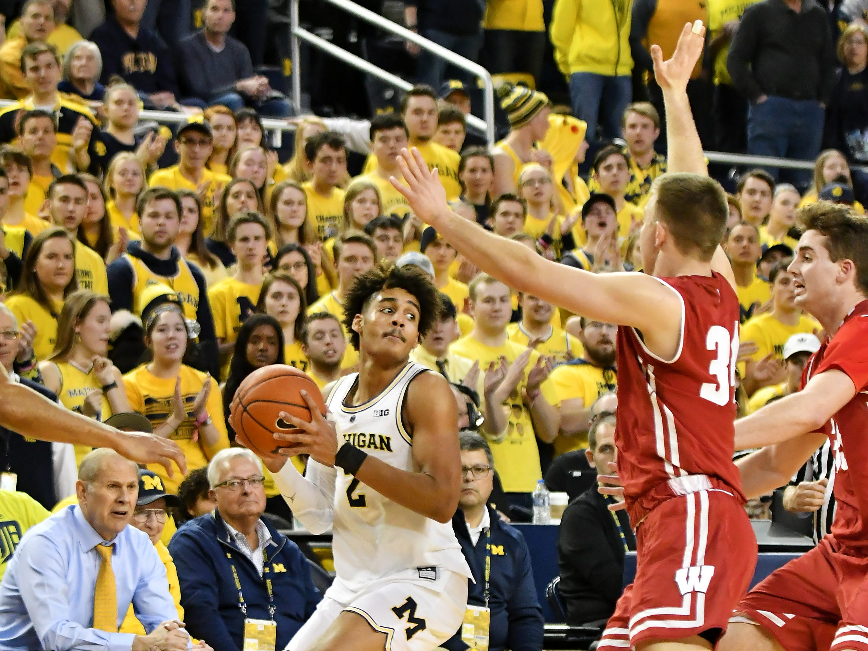 Wisconsin guard Brad Davison (34) and Wisconsin forward Nate Reuvers, right, come over to pressure Michigan guard Jordan Poole (2) in the second half.