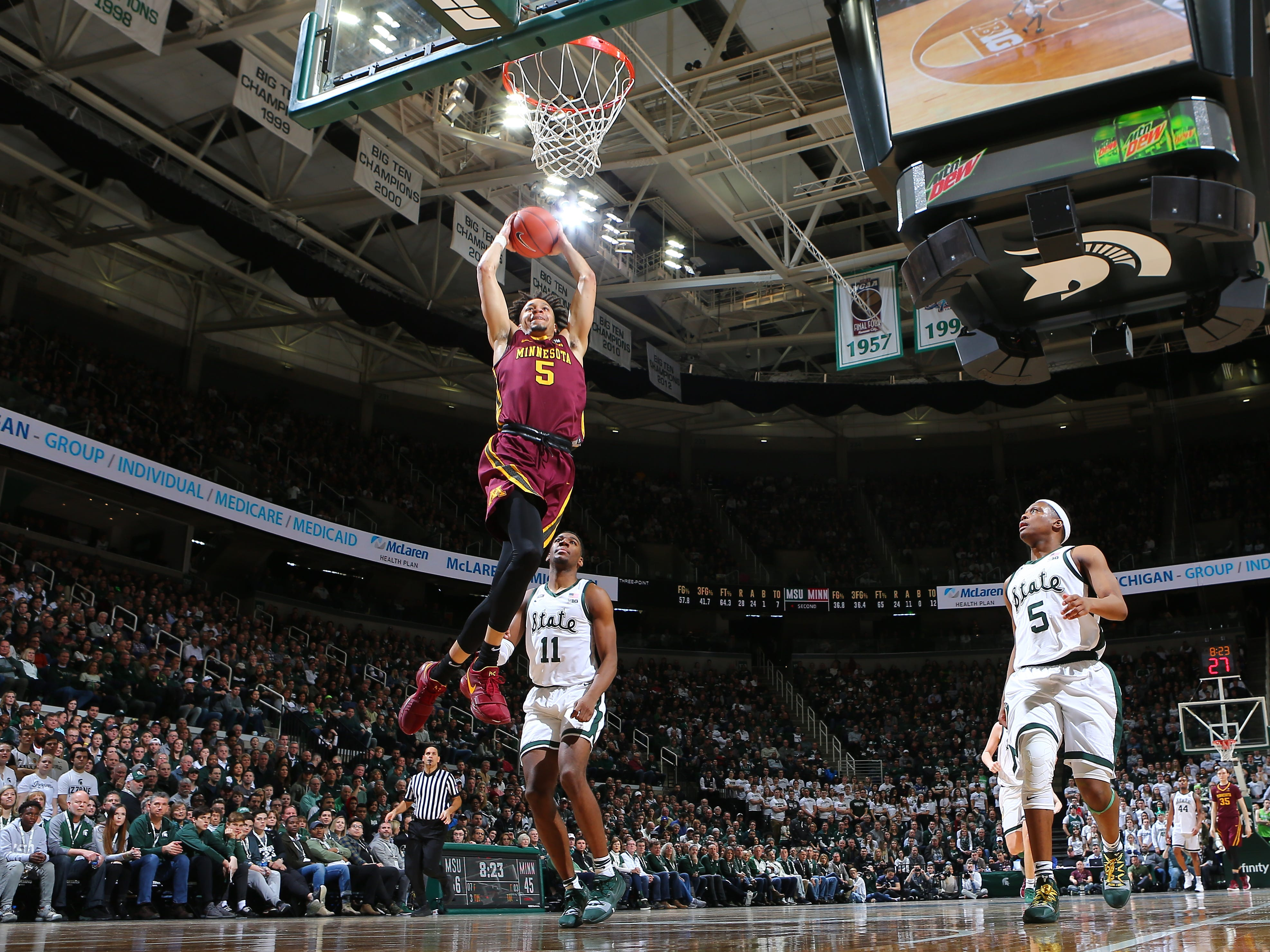Amir Coffey of the Minnesota Golden Gophers dunks the ball in the second half.
