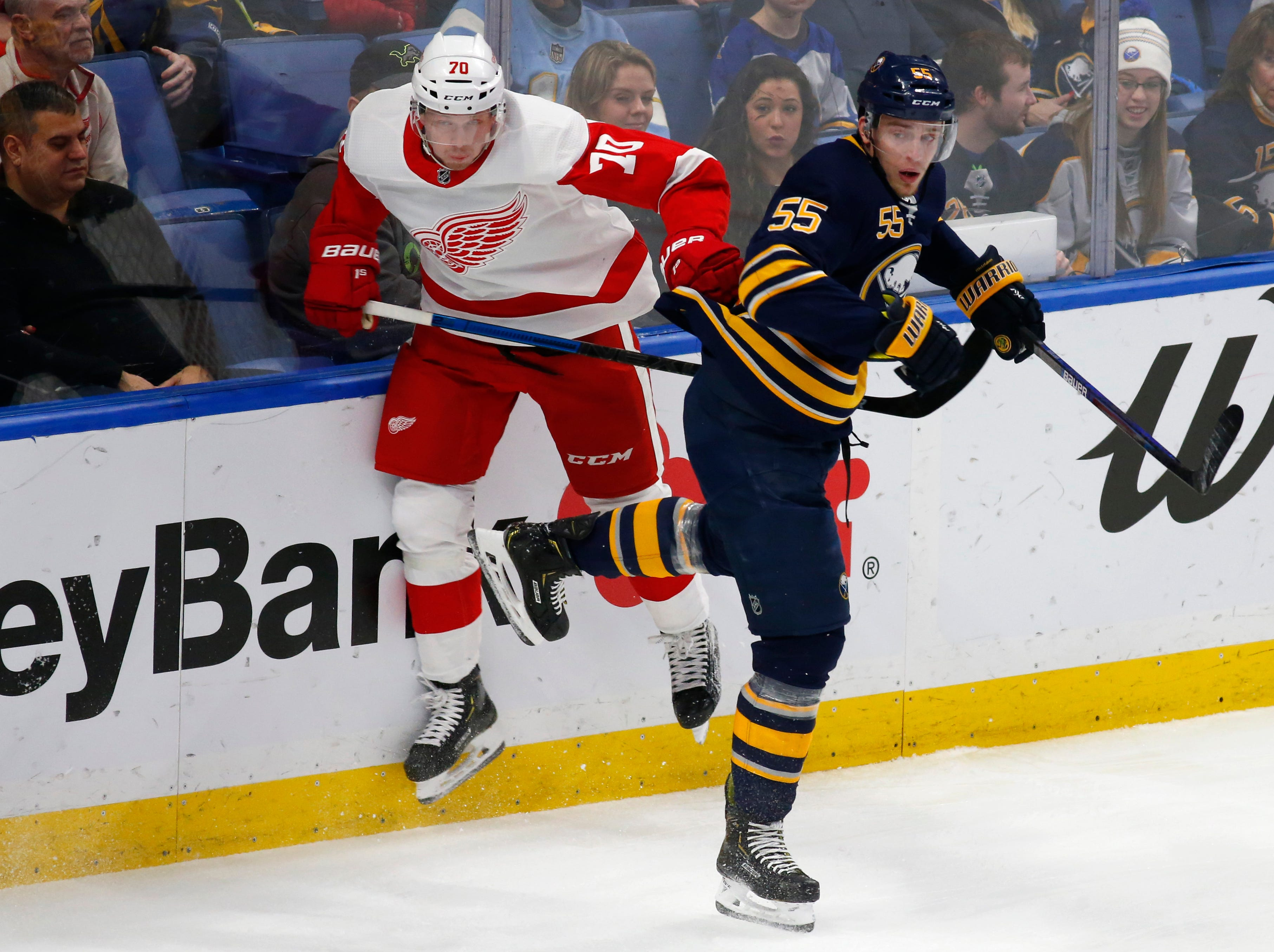 Buffalo Sabres defenseman Rasmus Ristolainen (55) and Detroit Red Wings forward Christoffer Ehn (70) collide during the first period of an NHL hockey game, Saturday, Feb. 9, 2019, in Buffalo N.Y. (AP Photo/Jeffrey T. Barnes)