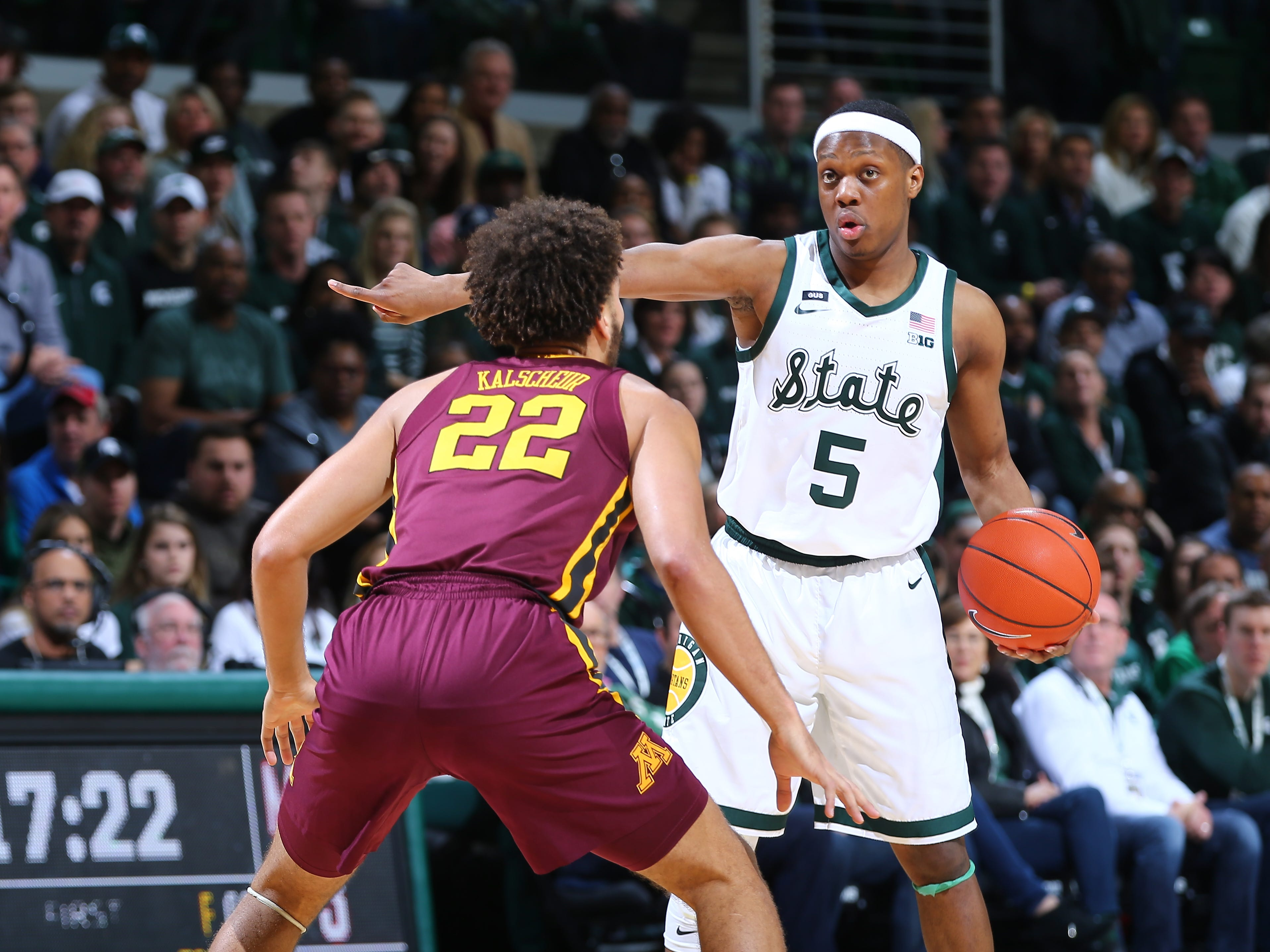 Cassius Winston of the Michigan State Spartans directs play while defended by Gabe Kalscheur of the Minnesota Golden Gophers in the first half at Breslin Center on February 9, 2019, in East Lansing, Michigan. Michigan State won the game 79-55.
