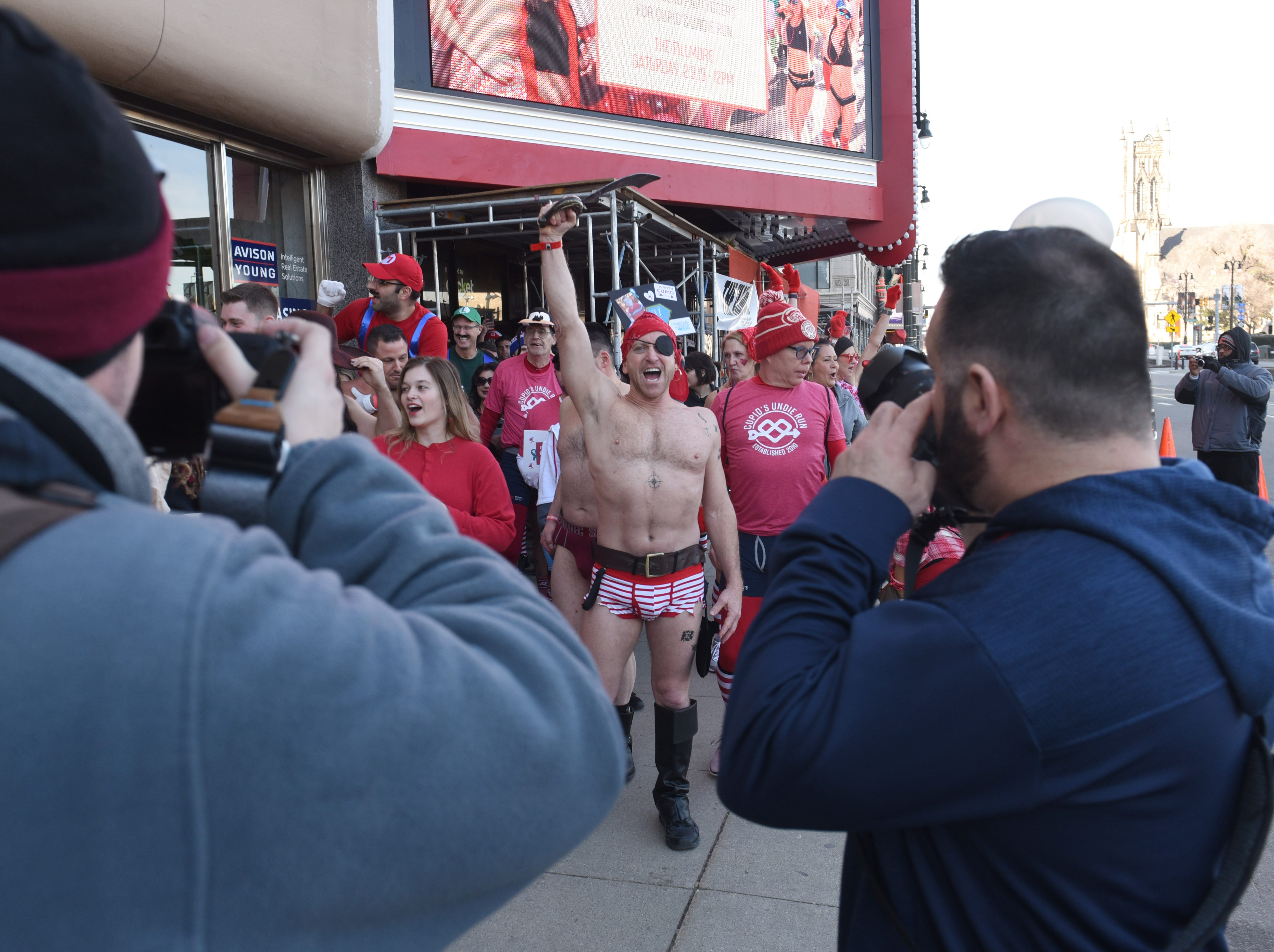 Participants shout and cheer outside The Fillmore Detroit for Cupid's Undie Run.