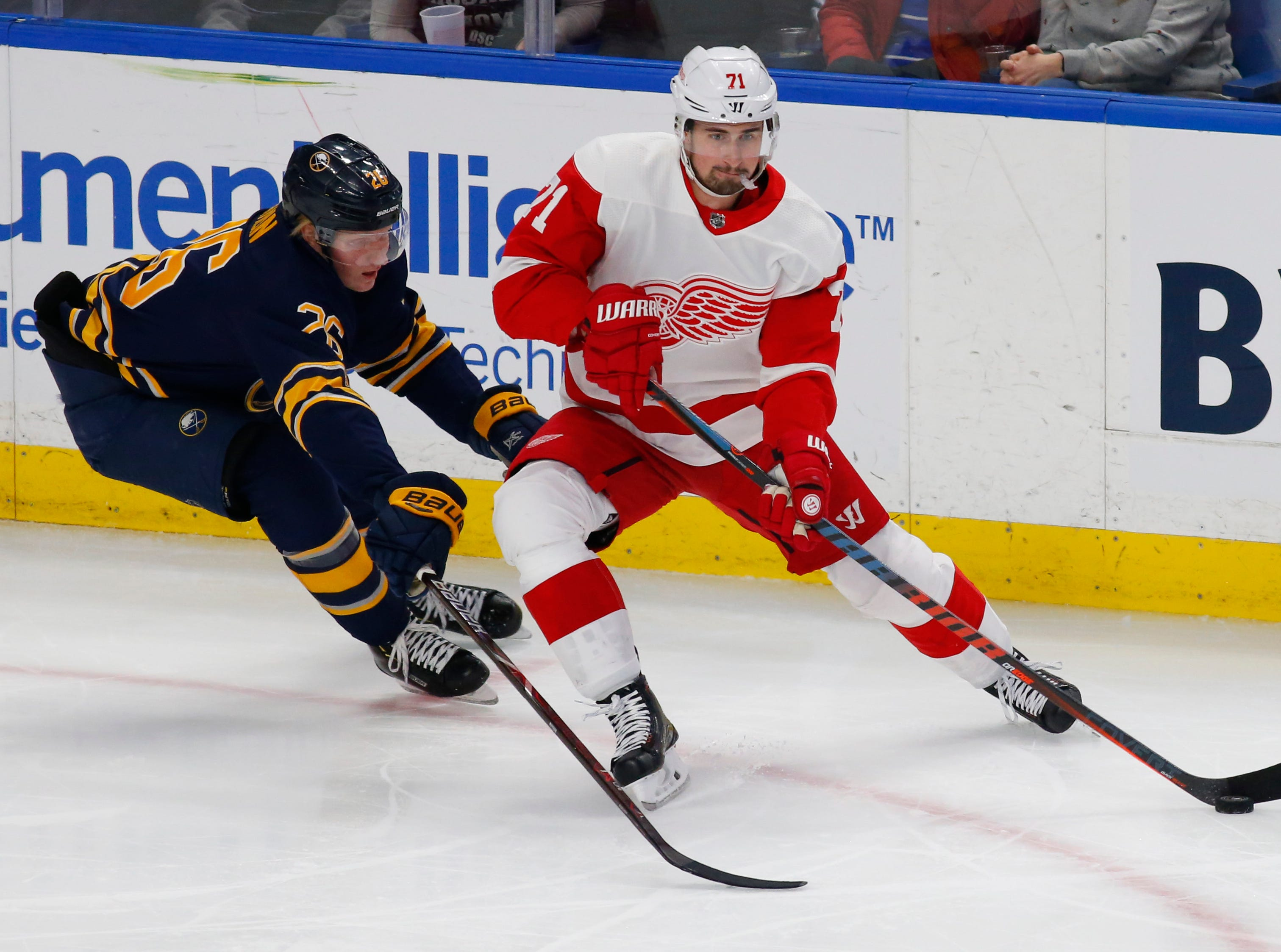 Buffalo Sabres defenseman Rasmus Dahlin (26) defends Detroit Red Wings forward Dylan Larkin (71) during the first period of an NHL hockey game, Saturday, Feb. 9, 2019, in Buffalo N.Y. (AP Photo/Jeffrey T. Barnes)