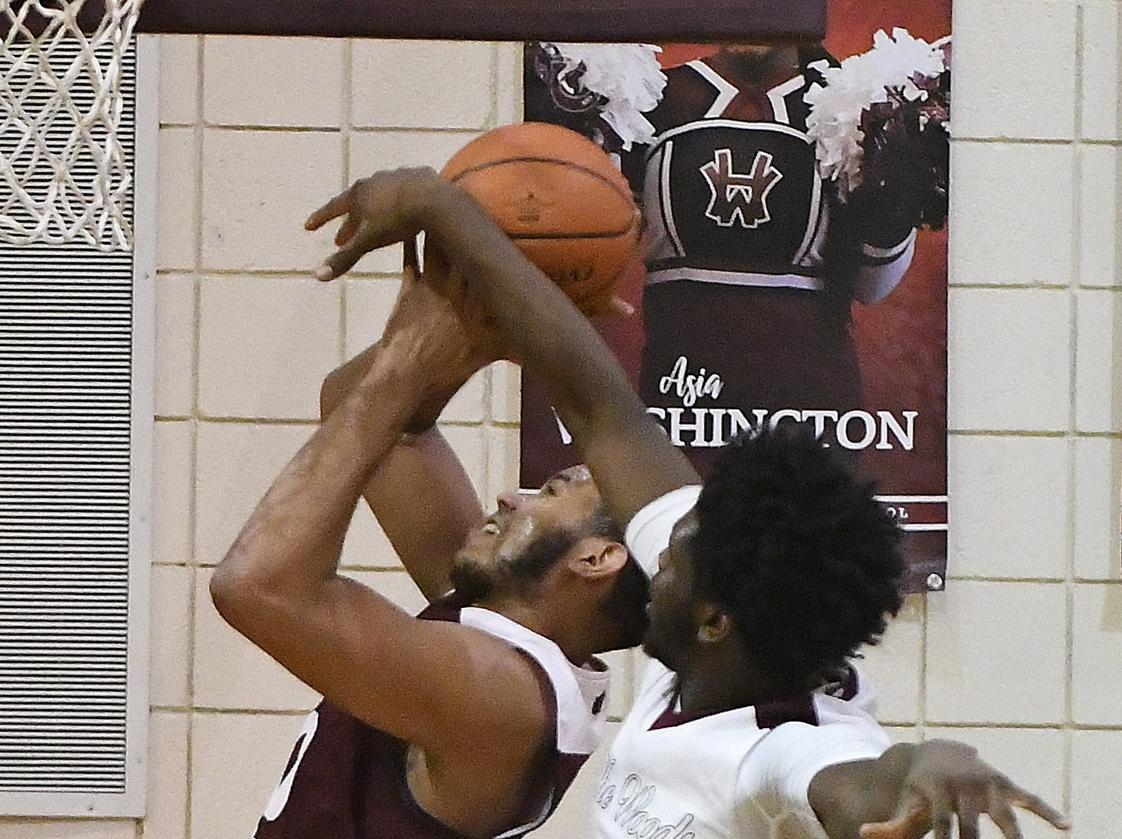 Harper Wood's Ken Thomas gets called for the over-the-back foul, blocking a shot by River Rouge's Dan Few in the first half.