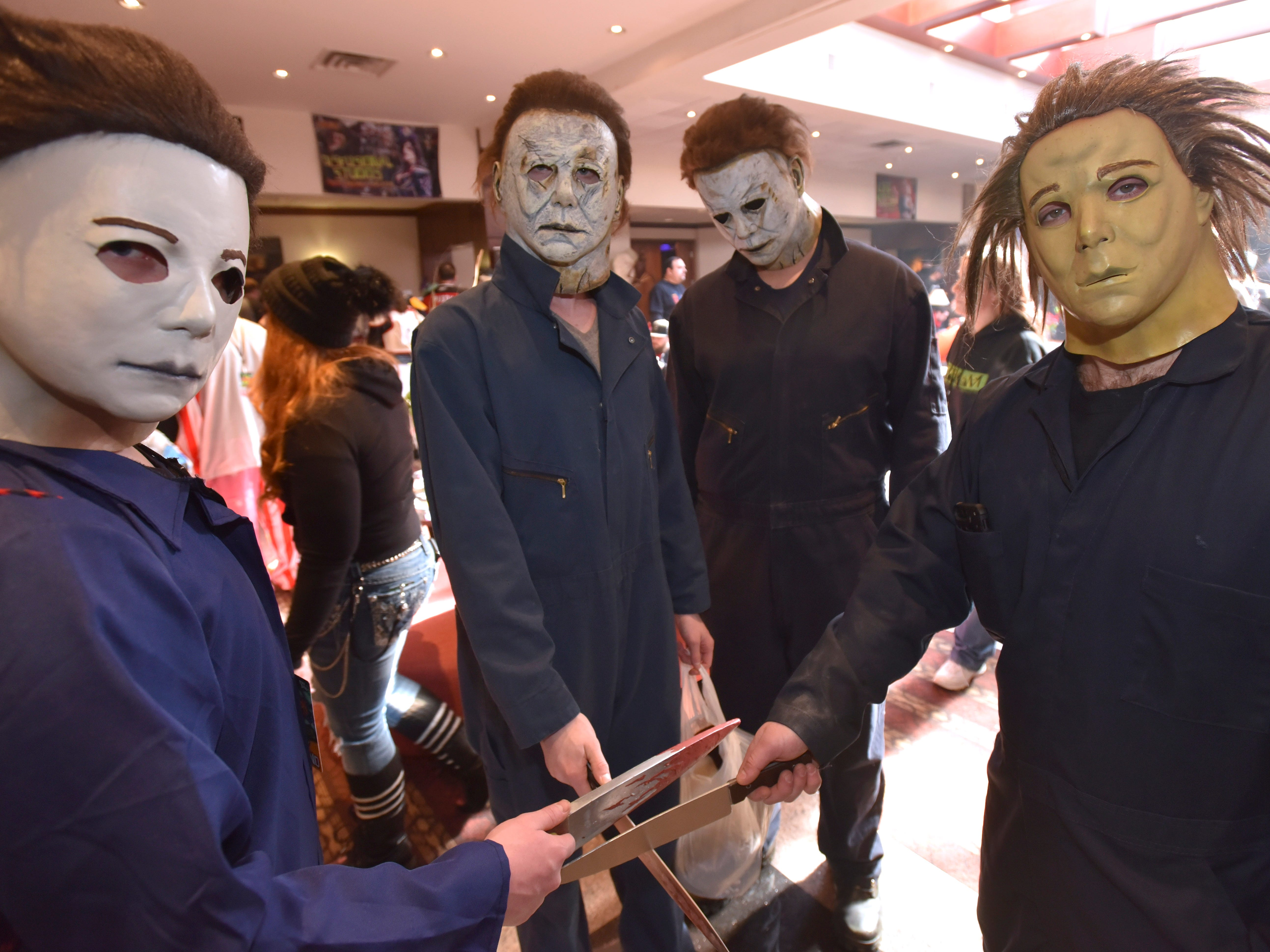 Four Michael Myers, the main character from the Halloween series of slasher films, are portrayed by, left to right, Dominic Wilks, 16, of Fraser, Seth Soetebeer, 17, of Rochester Hills, Jacob Cherry, 16, Auburn Hills, and Jason Shanker, 32, of Southfield, pose at the event.