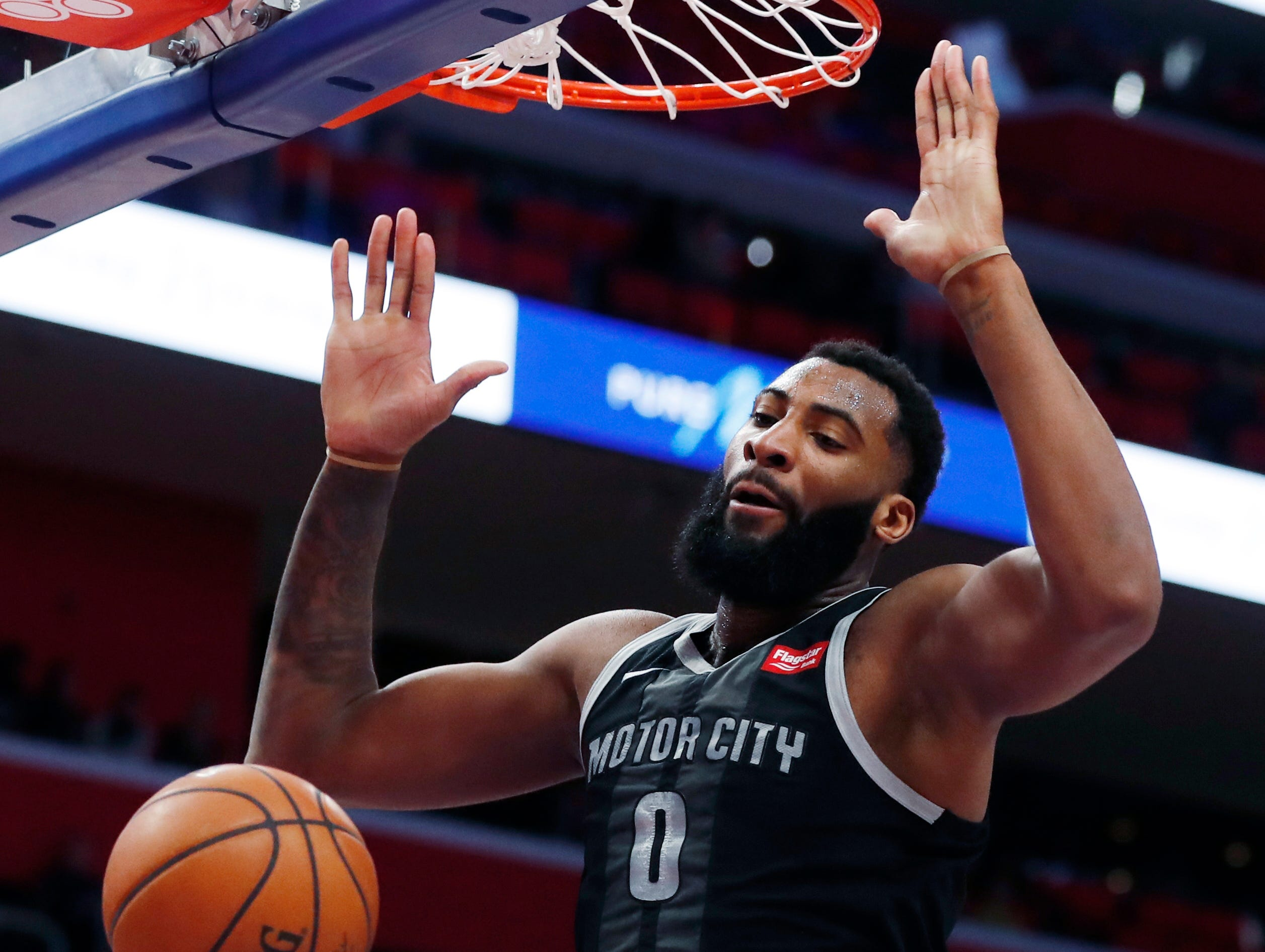 Detroit Pistons center Andre Drummond dunks during the first half of an NBA basketball game against the New York Knicks, Friday, Feb. 8, 2019, in Detroit.