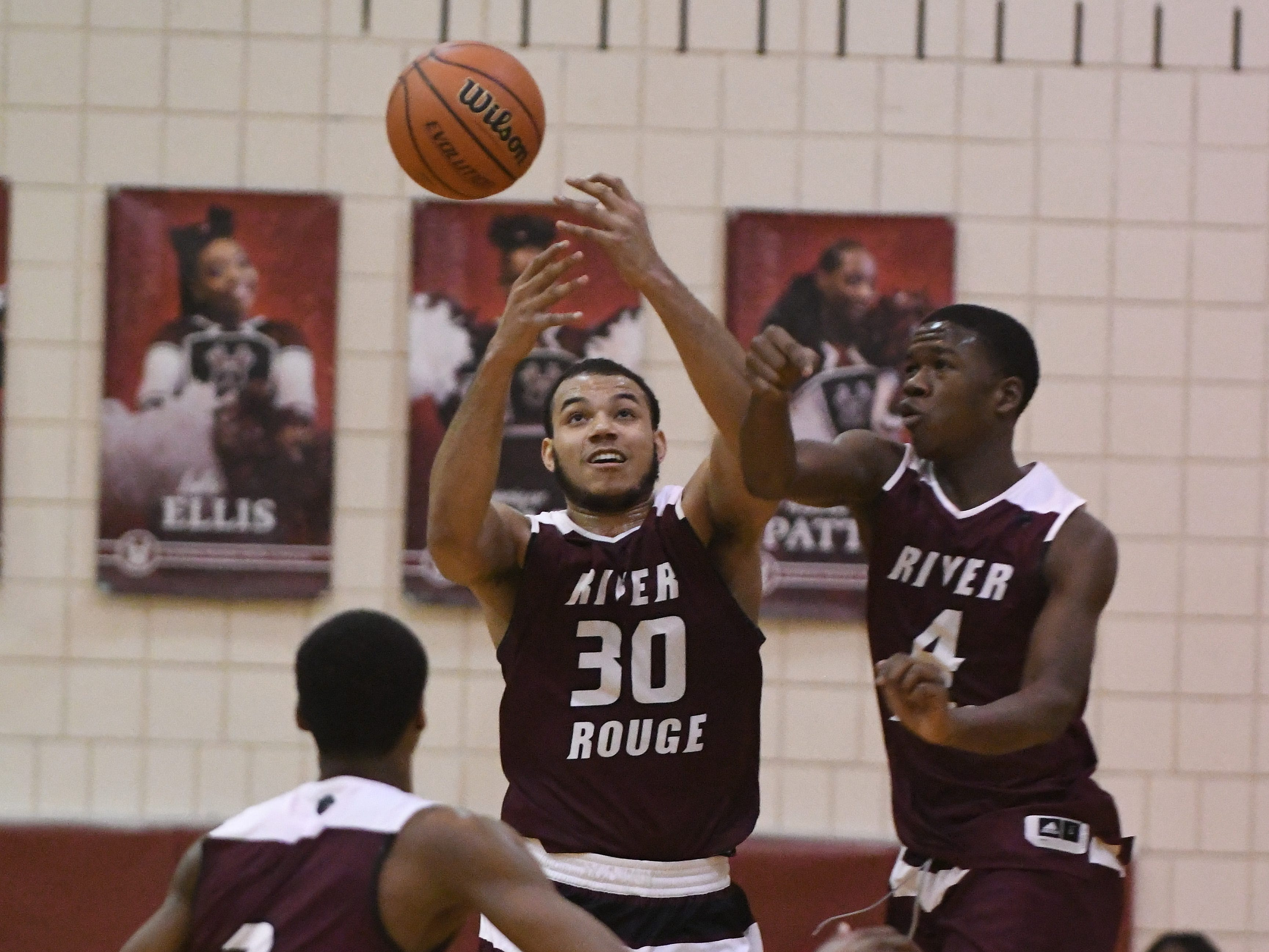 River Rouge's Micah Parrish, Dan Few and Legend Geeter chase down a loose ball in the second half.