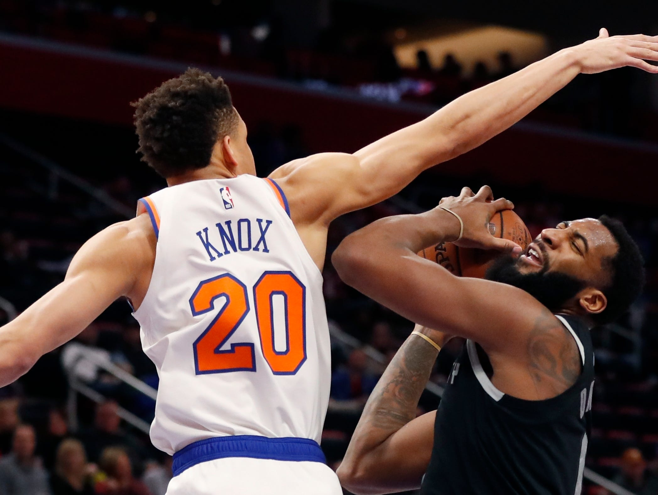 New York Knicks forward Kevin Knox (20) defends against Detroit Pistons center Andre Drummond during the first half of an NBA basketball game Friday, Feb. 8, 2019, in Detroit.