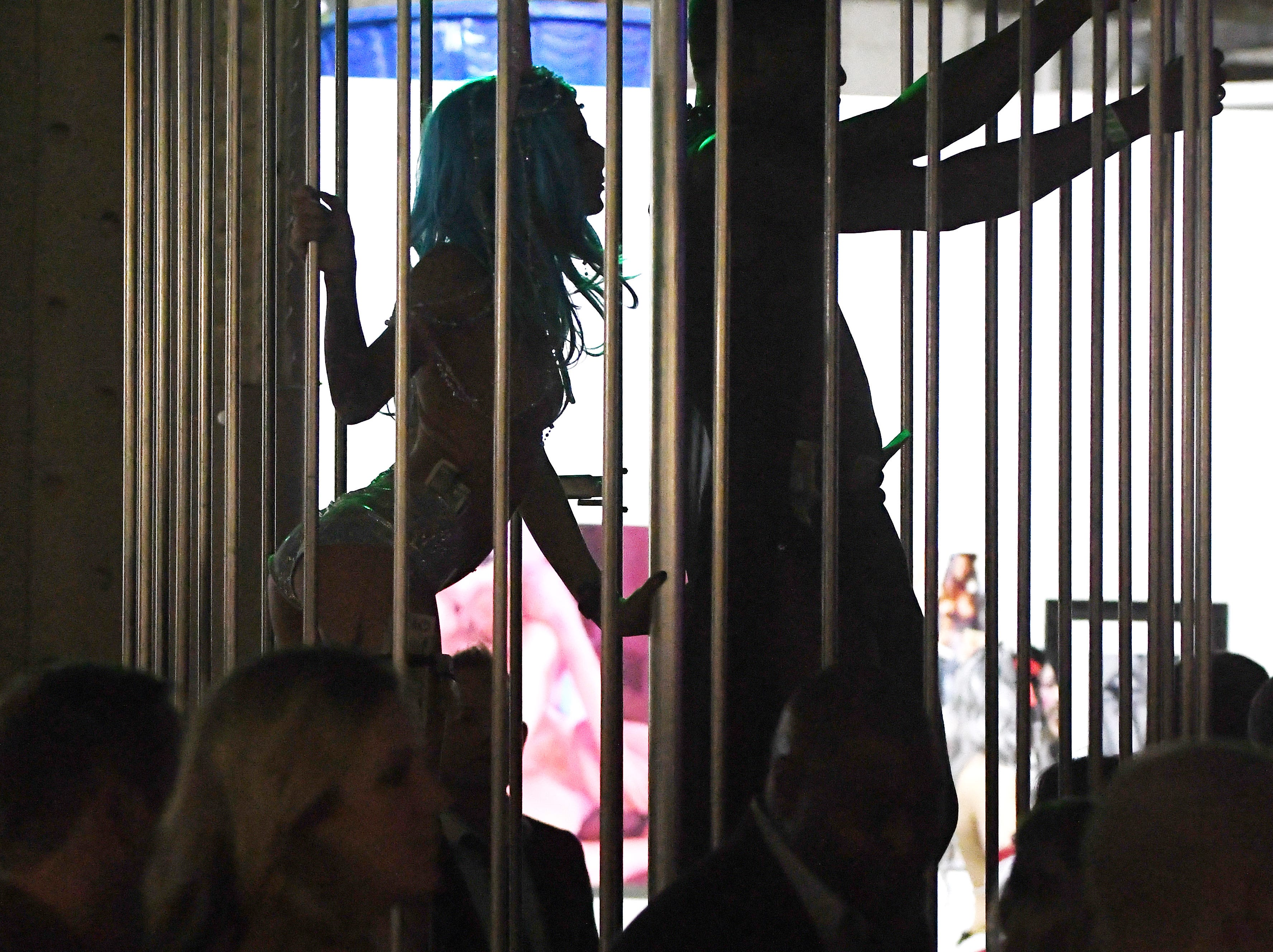 Caged dancers entertain the crowd at The 20th anniversary of the 'The Dirty Show.'