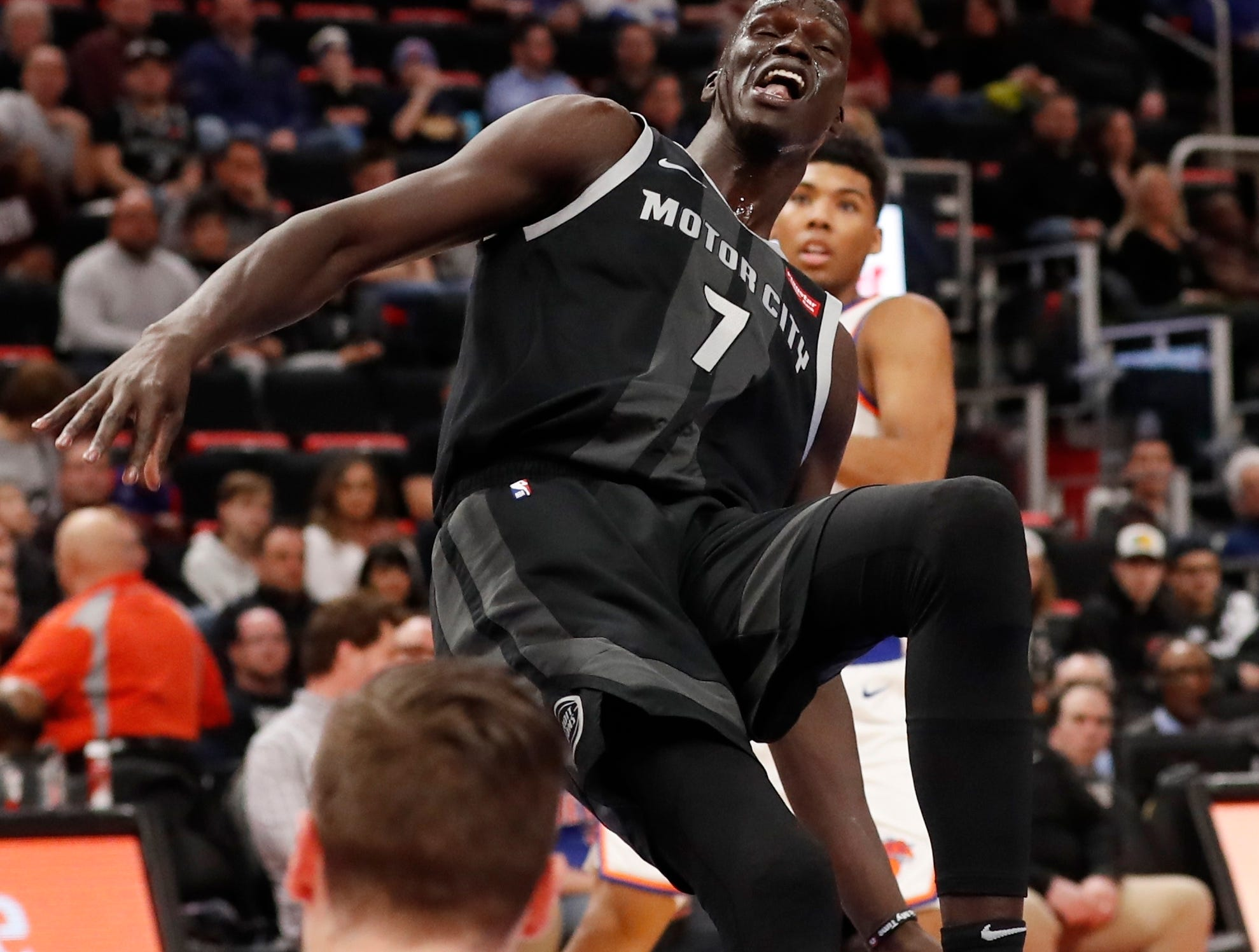 Detroit Pistons forward Thon Maker (7) is called for an offensive foul after running into New York Knicks forward Mario Hezonja (8) during the first half of an NBA basketball game Friday, Feb. 8, 2019, in Detroit.