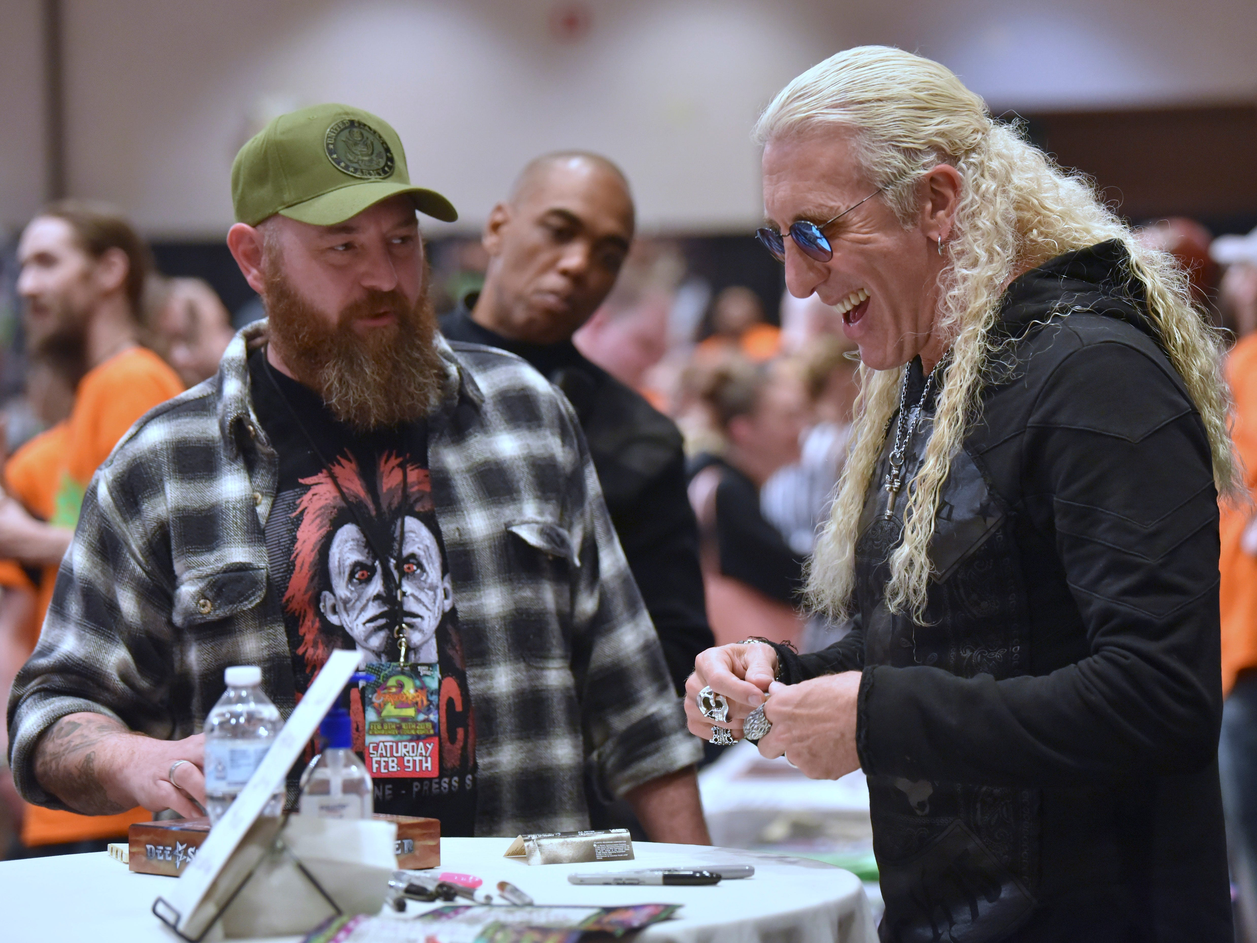 Twisted Sister frontman Dee Snider, right, shares a laugh with fan Jason Zielke, left, 44, of Redford, before signing his autograph on a painting that Zielke made of Snider, Friday. Snider is promoting his new solo album, 'For the Love of Metal.'