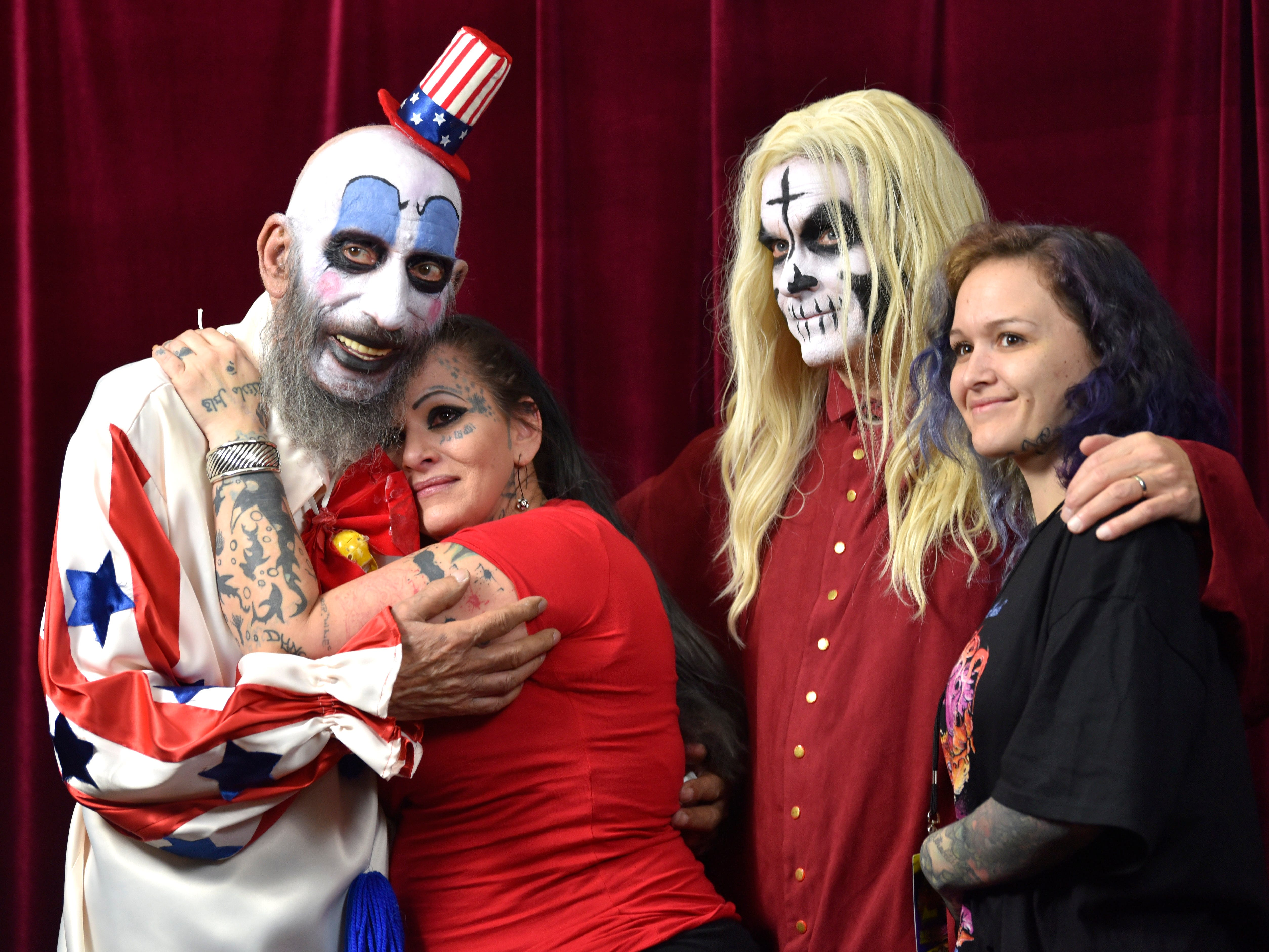 Rob Zombie's slasher / horror movie House of 1000 Corpses characters 'Captain Spaulding,' left, portrayed by Sid Haig, and 'Otis B. Driftwood,' right, portrayed by Bill Moseley, pose with Wendy 'The Tattoo Artist' Whalin, 48, and her daughter, Brittany 'Killa B', respectively, both of Detroit, during a Hollywood Photo Ops portrait session.