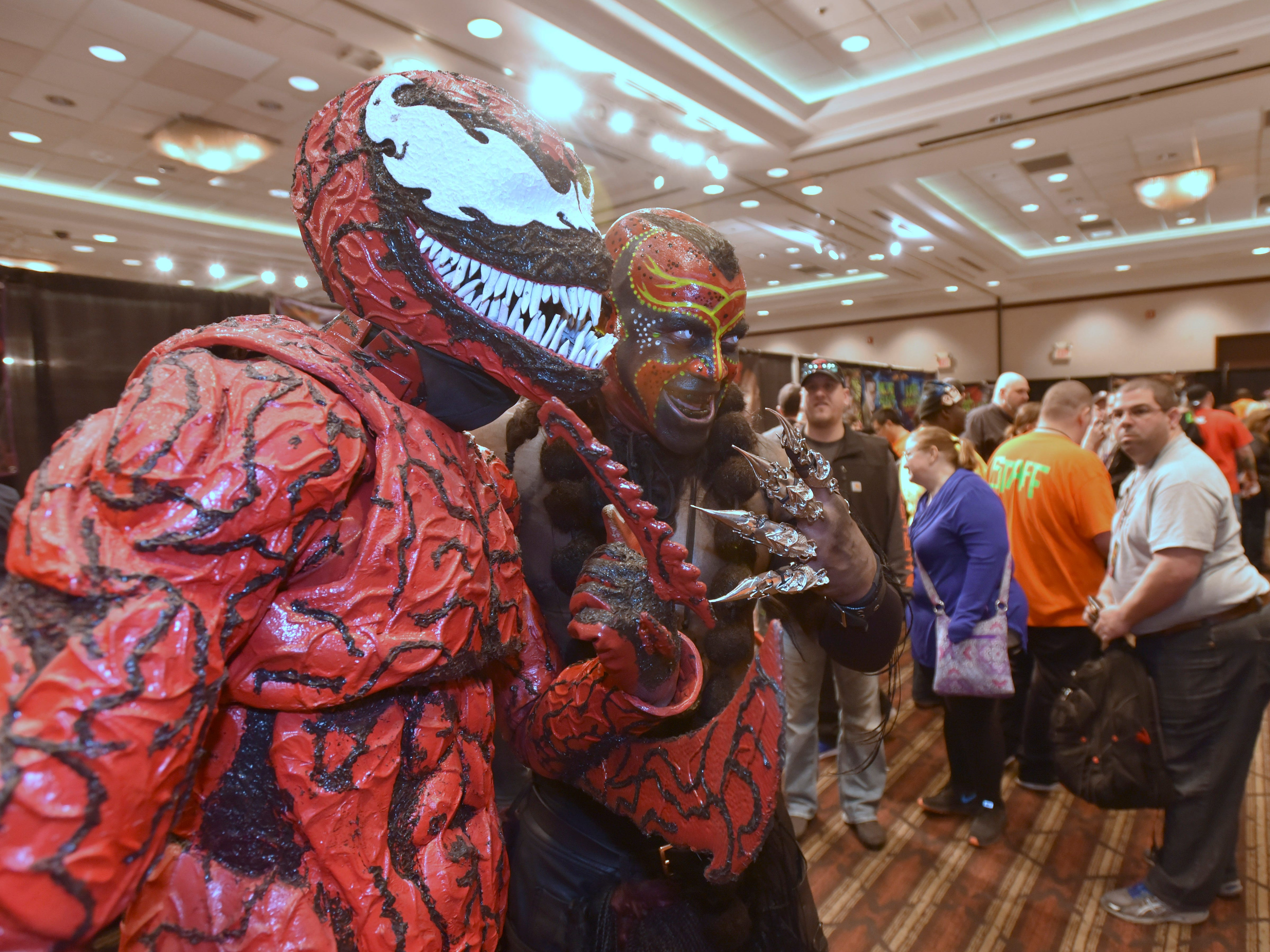 WWE Superstar wrestler 'The Boogeyman,' portrayed by Marty Wright, right, of Denver, Colorado, poses with 'Carnage,' portrayed by Cody Schuyler, left, 28, of Walpole Island, Ontario, Canada.