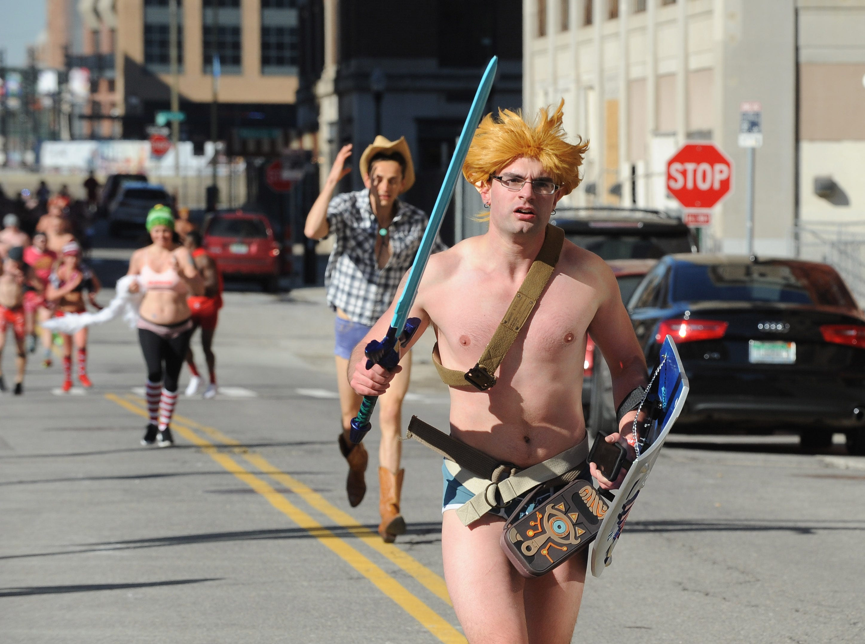 Plenty of warriors and cowboys ran the streets around the The Fillmore Detroit for Cupid's Undie Run.