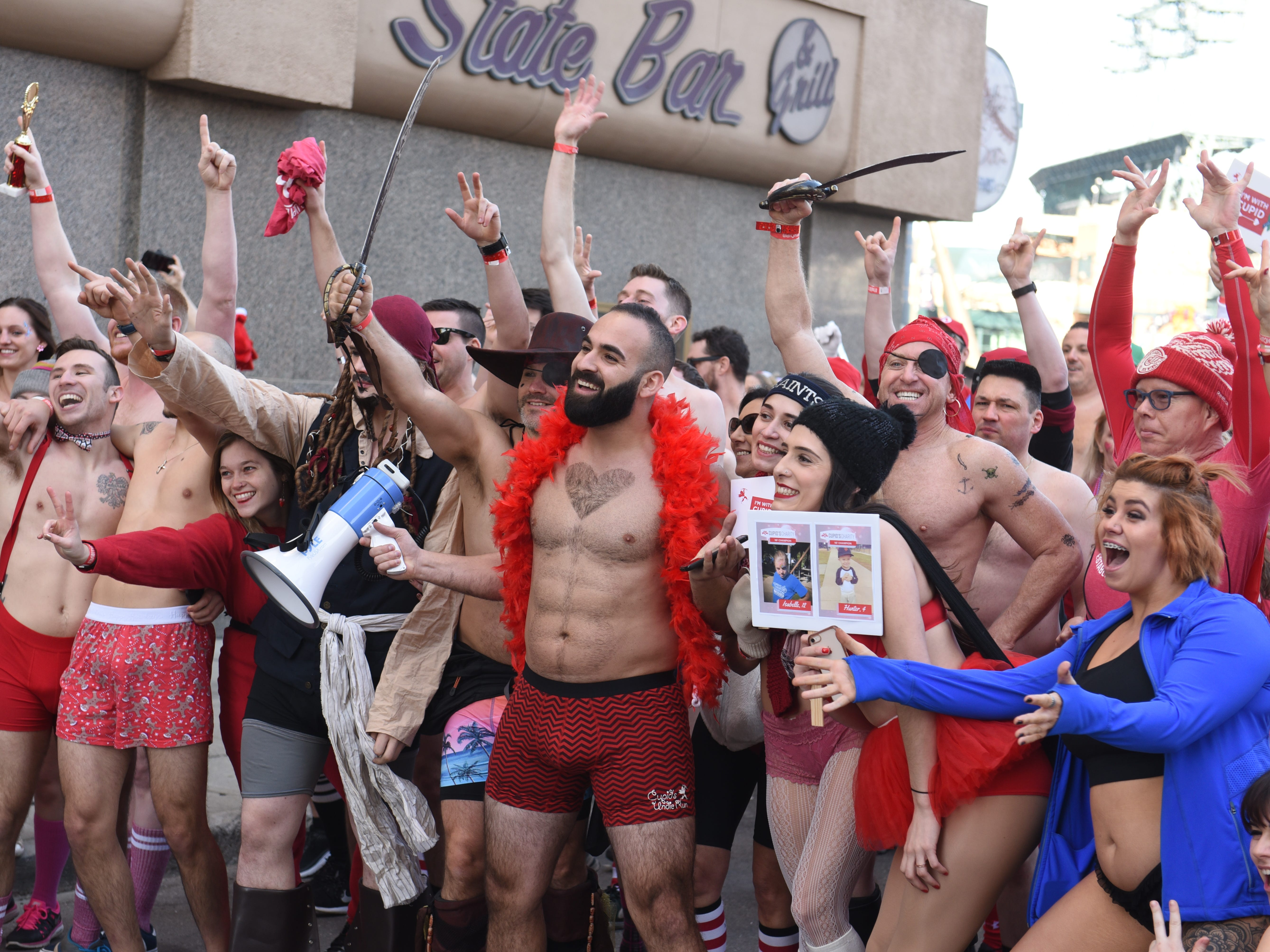 Participants pose for a photograph moments before Cupid's Undie Run on Saturday, February 9, 2019.