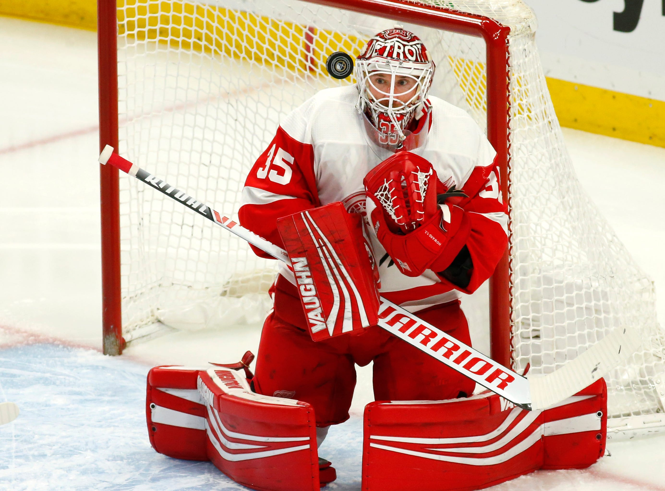 Detroit Red Wings goalie Jimmy Howard (35) makes a save during the first period of an NHL hockey game against the Buffalo Sabres, Saturday, Feb. 9, 2019, in Buffalo N.Y. (AP Photo/Jeffrey T. Barnes)