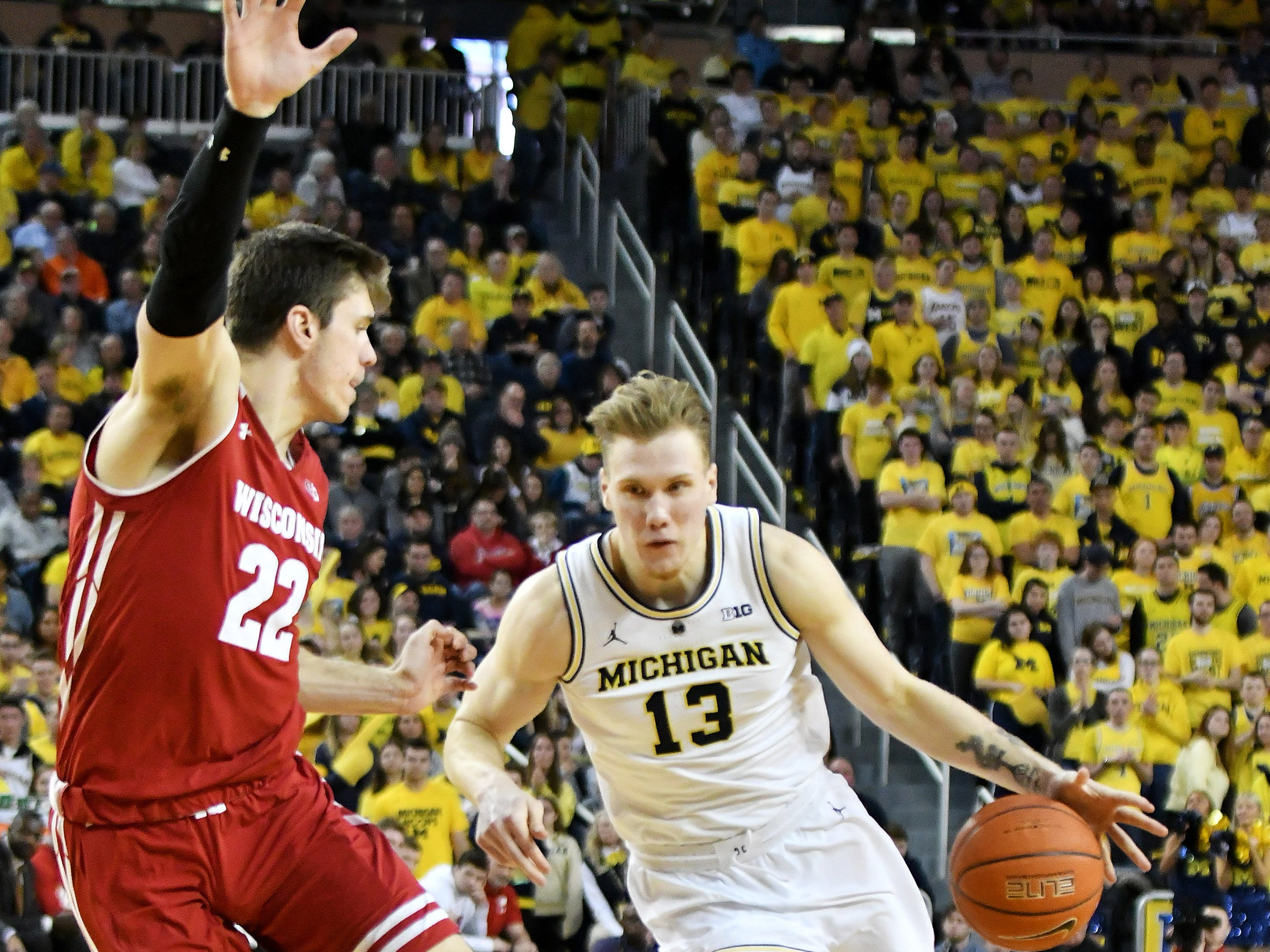 Wisconsin forward Ethan Happ (22) guards Michigan forward Ignas Brazdeikis (13) in the second half.
