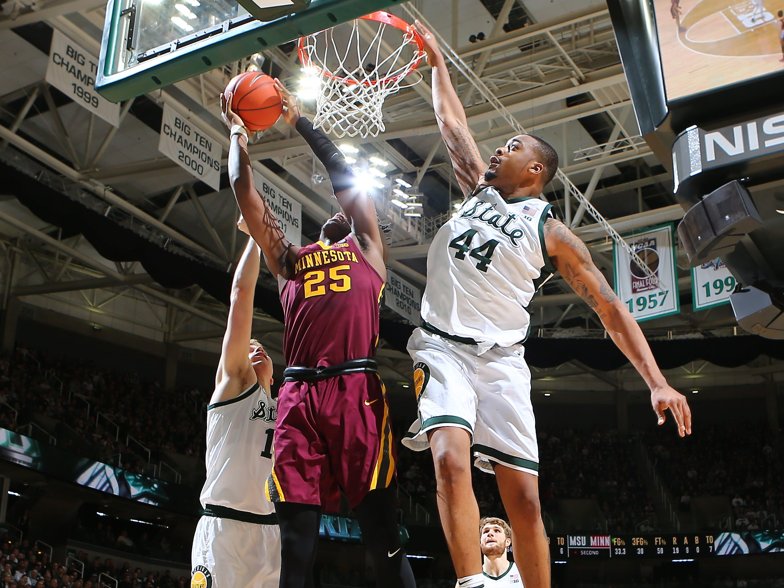 Daniel Oturu of the Minnesota Golden Gophers shoots the ball against Nick Ward in the second half.