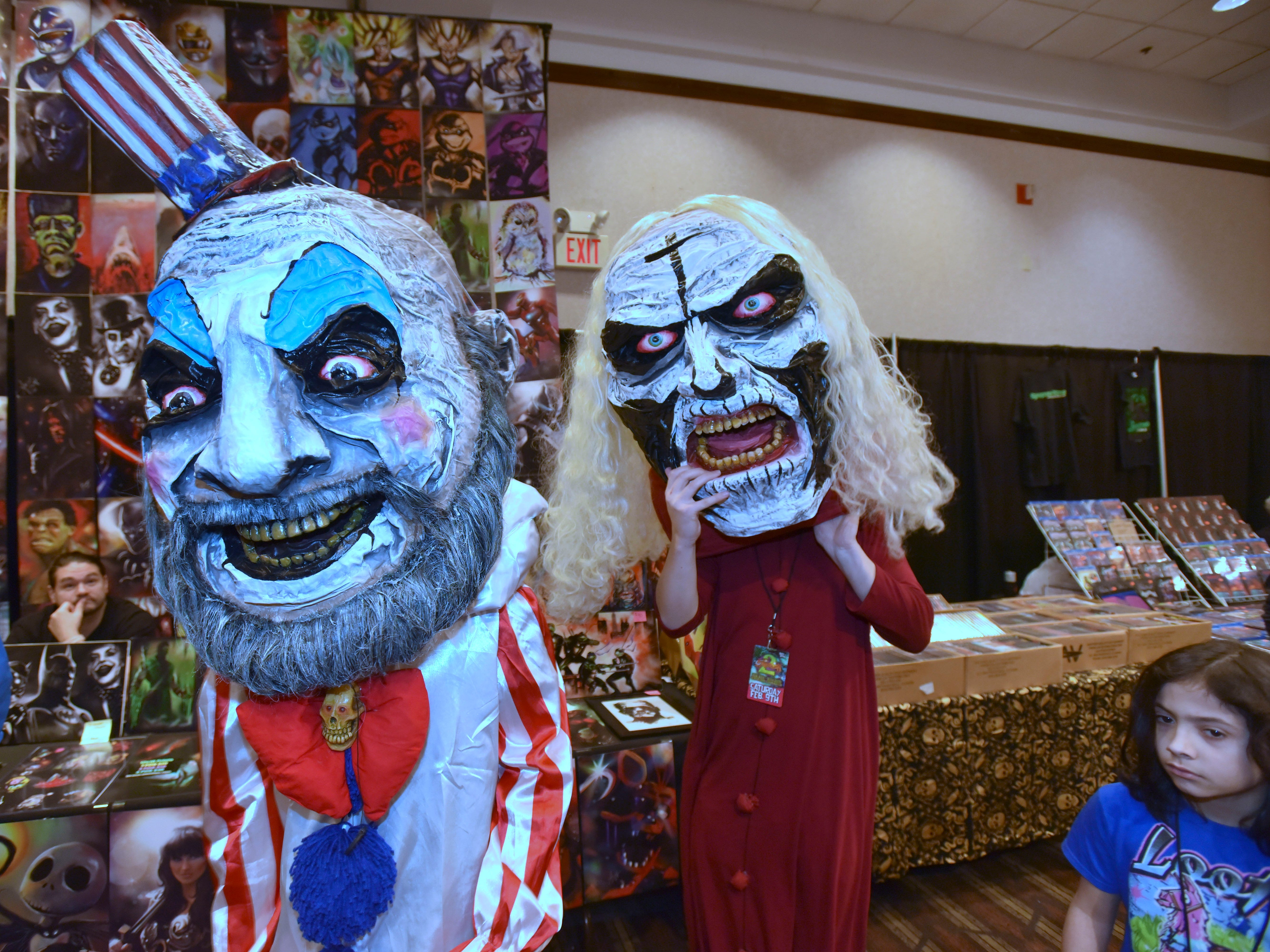 Rob Zombie's slasher / horror movie House of 1000 Corpses characters 'Captain Spaulding,' left, and 'Otis B. Driftwood' right, are portrayed by friends Phoenix Kelley, 22, and Allen Orman, 23, respectively, both of Brazil, Indiana, as they wear self-made, paper mache heads.