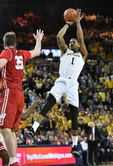 Michigan guard Charles Matthews (1) hits a shot in the last minute in the second half Saturday against Wisconsin. Matthews scored 16 of his 18 points in the second half in a 61-52 Wolverines' victory over the Badgers.
