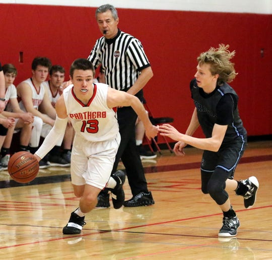 Noah Mack of Spencer-Van Etten dribbles up the floor as Gavin Stayton of Moravia defends Feb. 8, 2019 at Spencer-Van Etten High School.