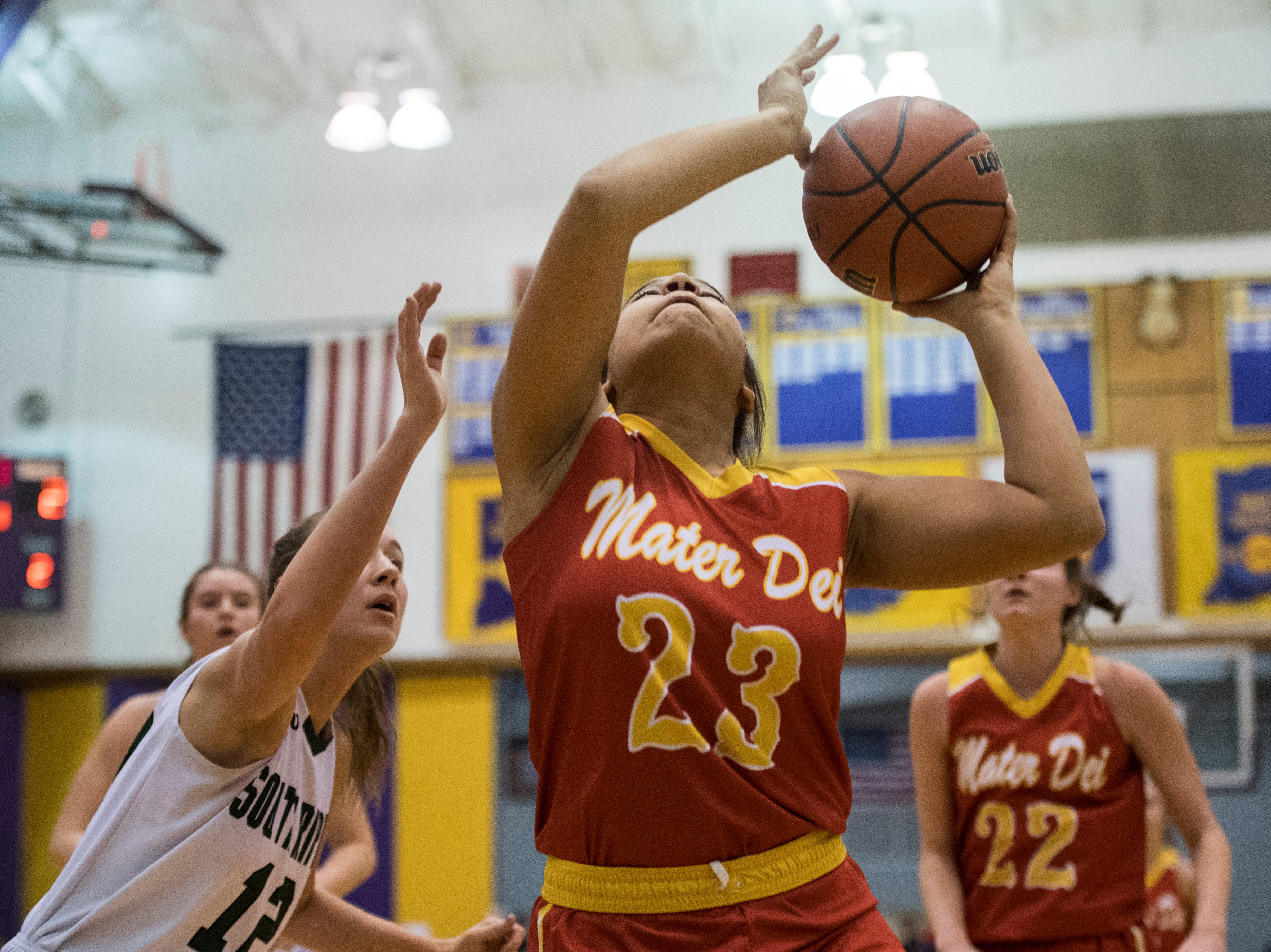 Mater Dei's Mariah Dickerson (23) takes a shot during the IHSAA Class 2A Girls' Basketball Regional #12 game against the against the South Ripley Raiders at Paoli Jr. Sr. high school Saturday, Feb. 9, 2019.