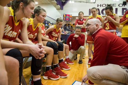 Mater Dei coach Chad Breeden directs players during a timeout against South Ripley in the regional at Paoli High School.